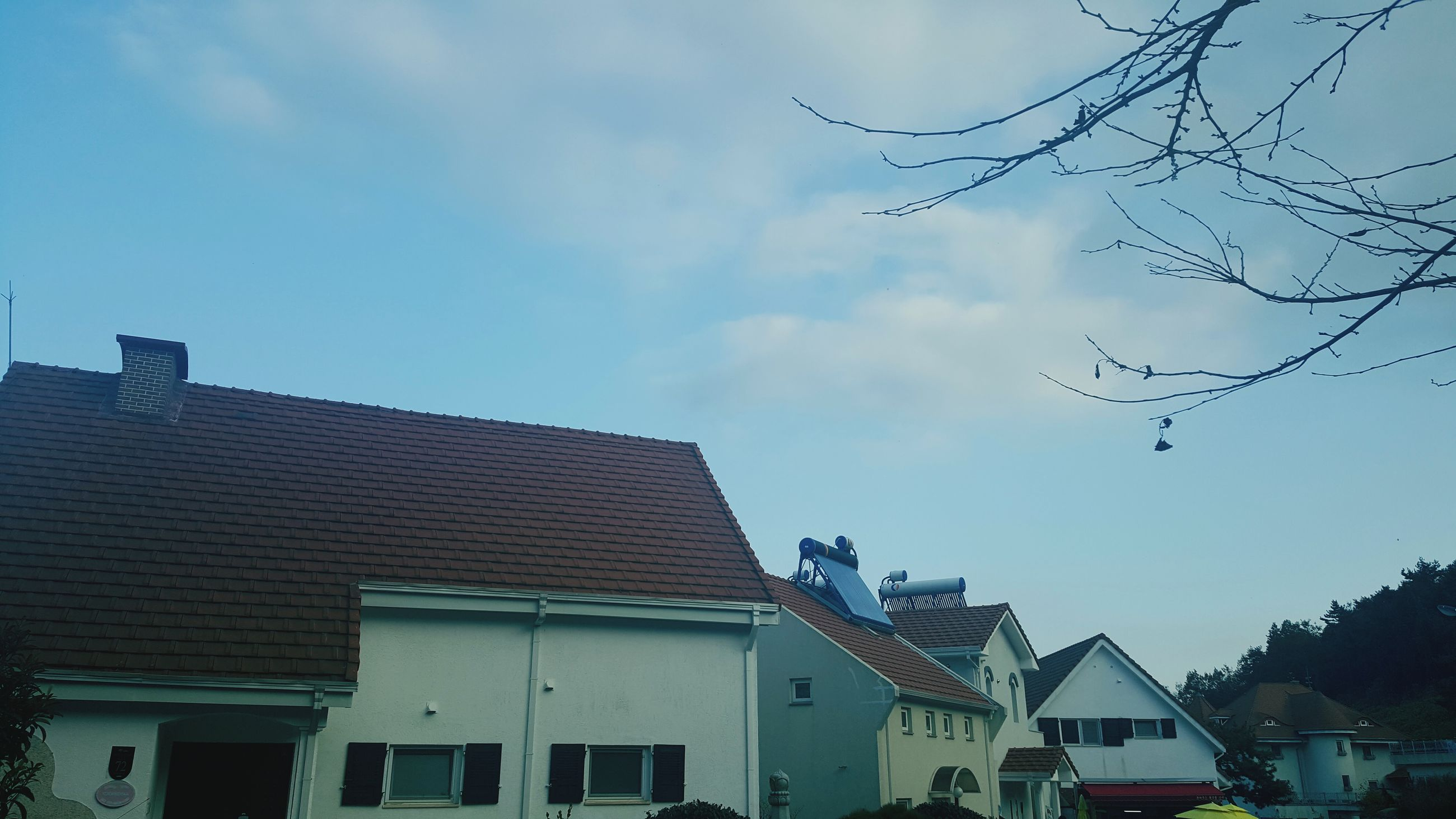 building exterior, architecture, built structure, window, sky, city, low angle view, day, no people, outdoors, cloud - sky