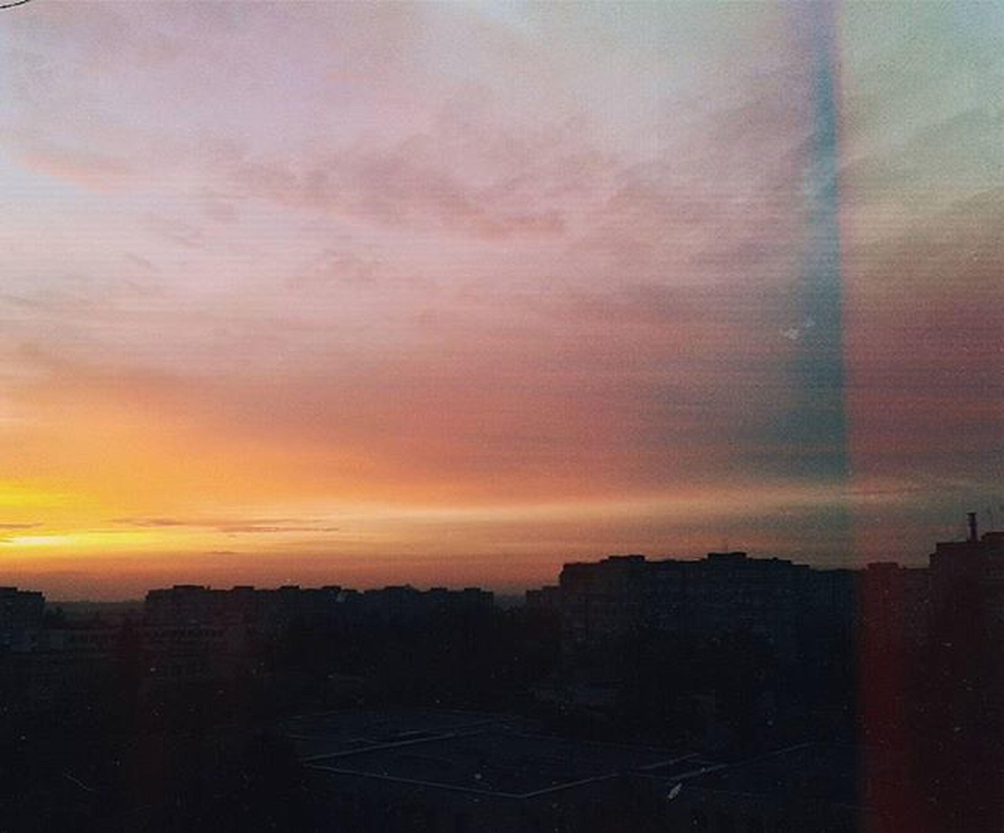 sunset, building exterior, architecture, built structure, city, cityscape, orange color, sky, silhouette, residential building, cloud - sky, residential structure, residential district, building, no people, outdoors, skyscraper, cloud, crowded, nature