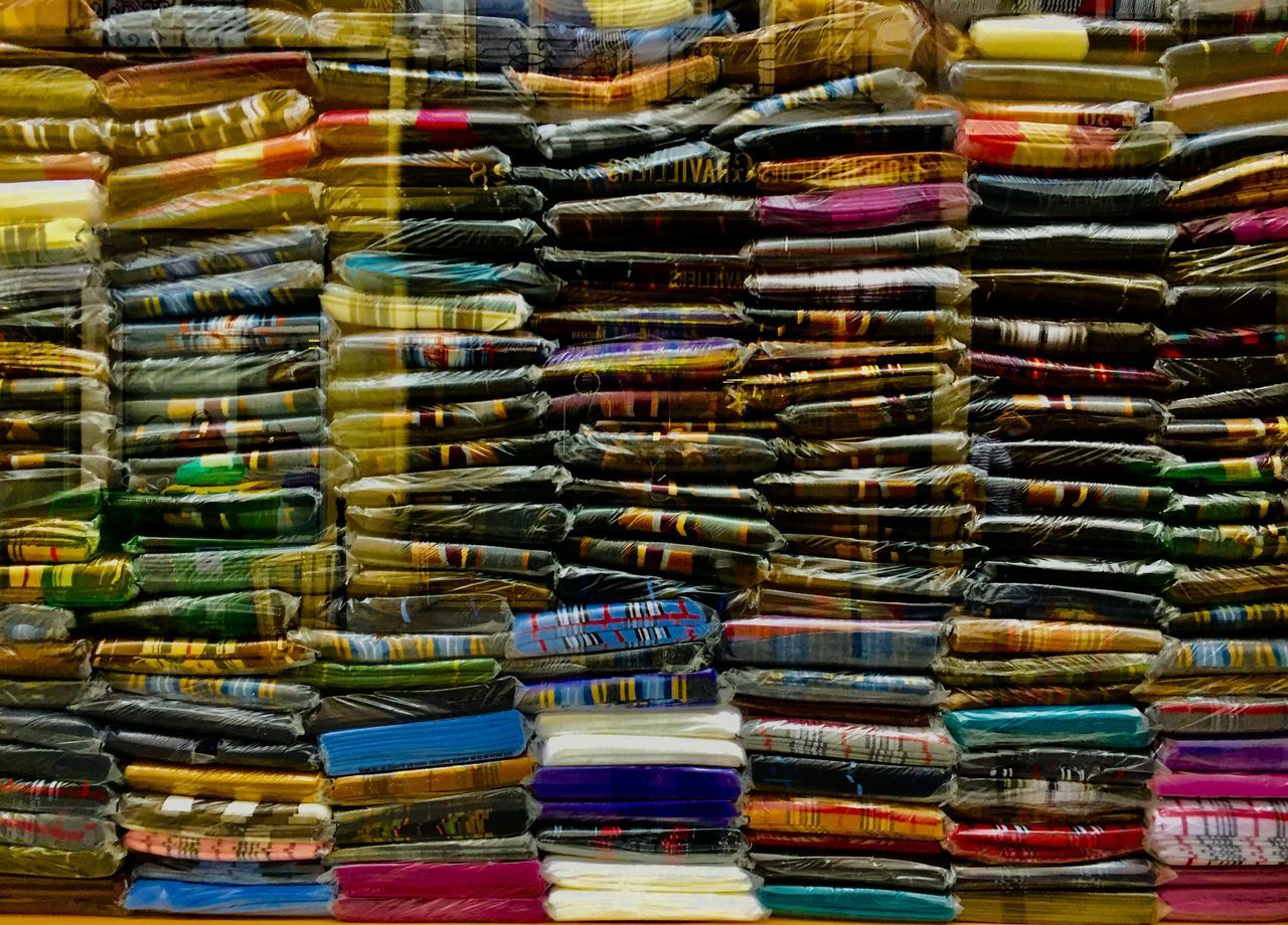 large group of objects, variation, multi colored, for sale, choice, abundance, retail, stack, no people, market, arrangement, day, indoors, close-up
