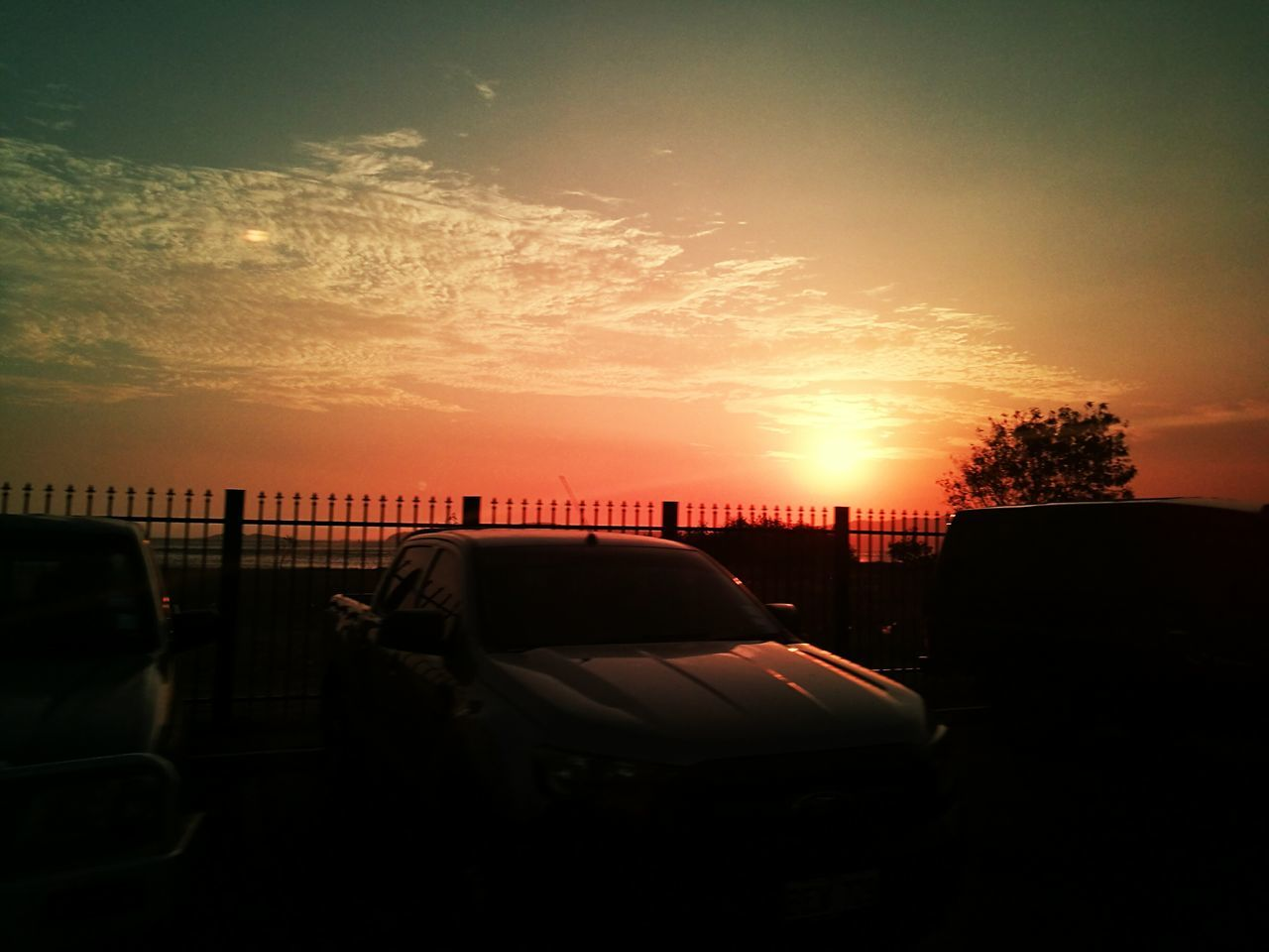 car, sunset, land vehicle, transportation, mode of transport, sky, silhouette, no people, outdoors, tree, day