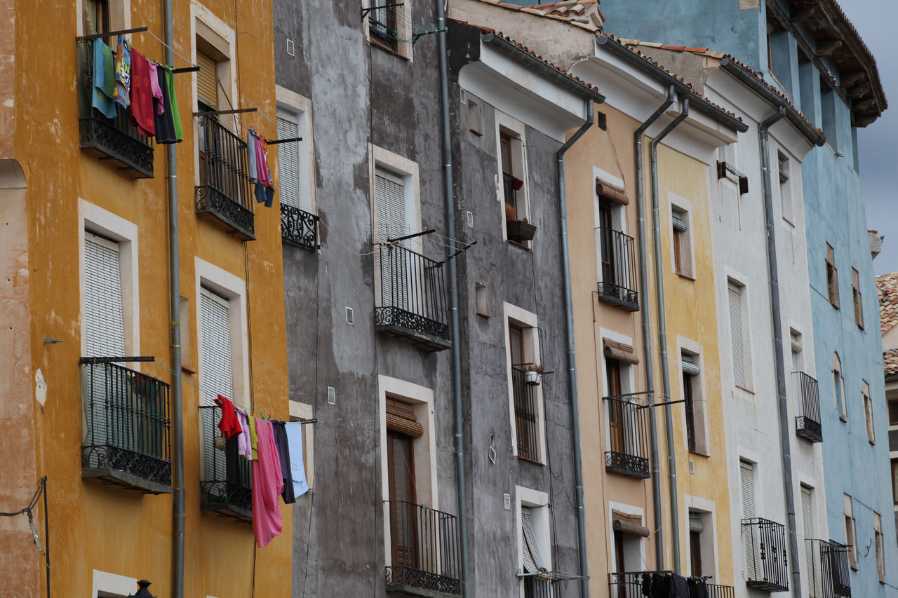 building exterior, architecture, window, balcony, building, clothesline, clothing, hanging, laundry, built structure, residential building, drying, no people, outdoors, day