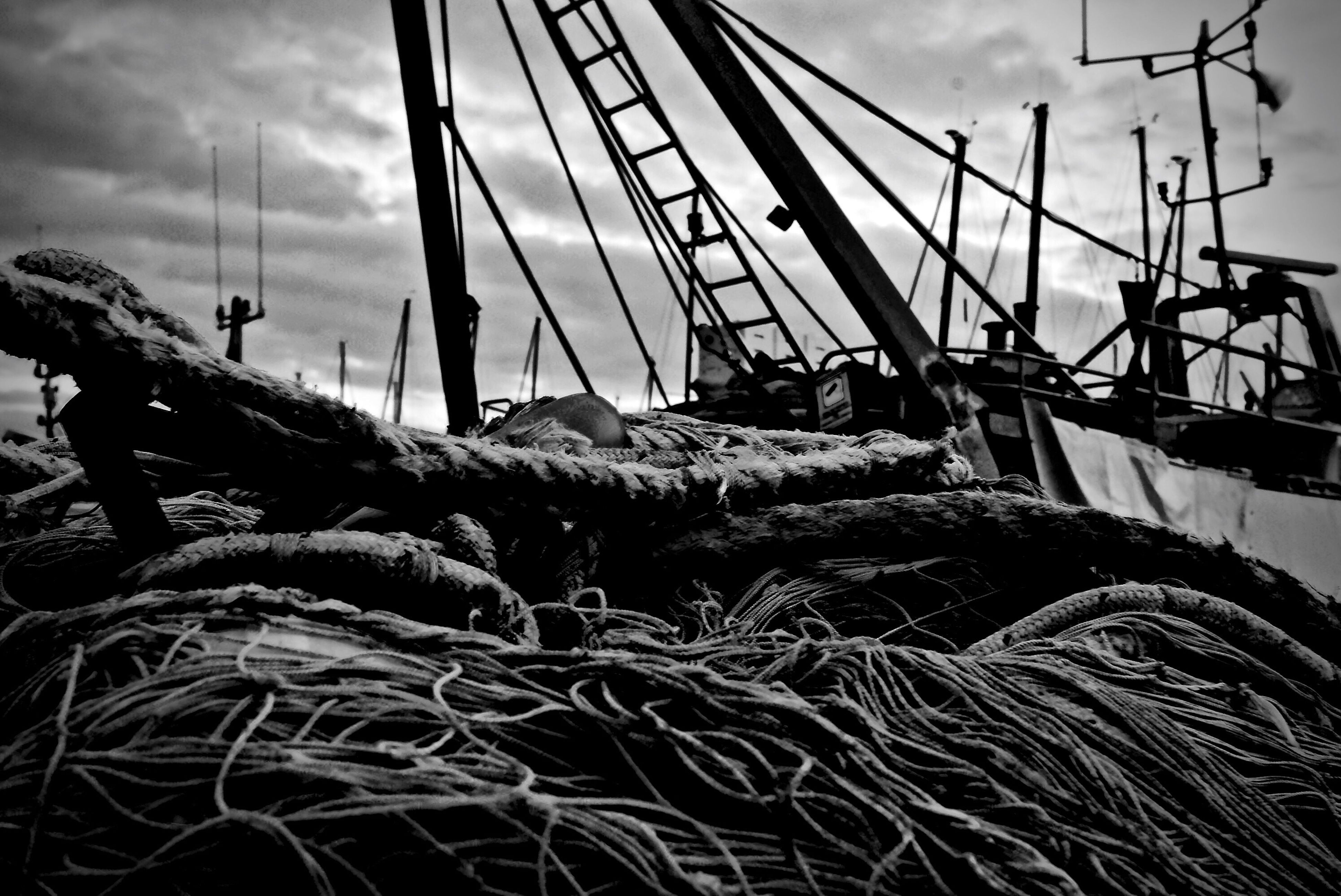 sky, transportation, cloud - sky, nautical vessel, nature, outdoors, sea, day, fishing net, water, beach, no people, harbor, beauty in nature, rigging, close-up