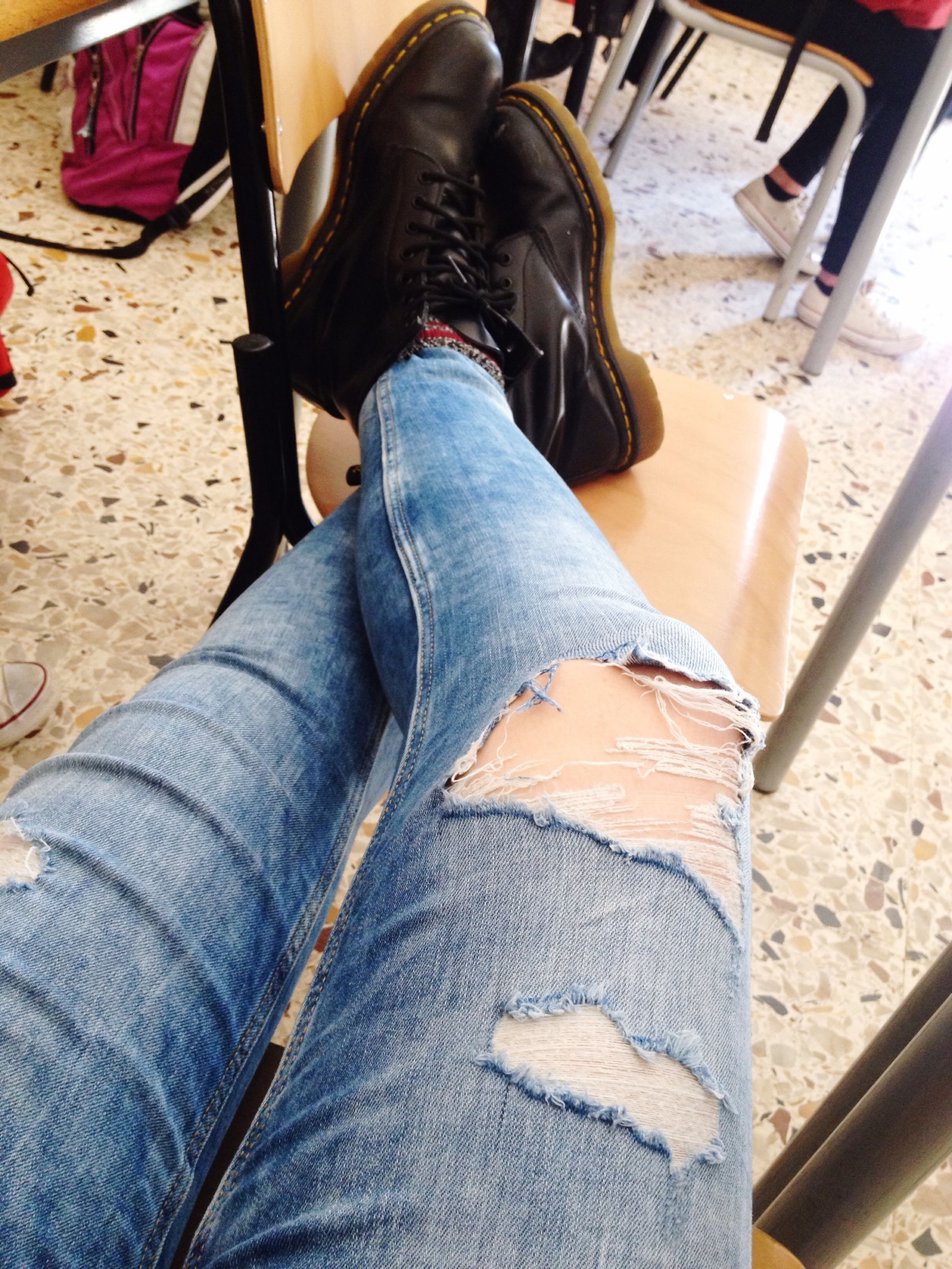 low section, person, shoe, jeans, lifestyles, footwear, sitting, personal perspective, human foot, casual clothing, standing, leisure activity, men, part of, transportation, high angle view, fashion