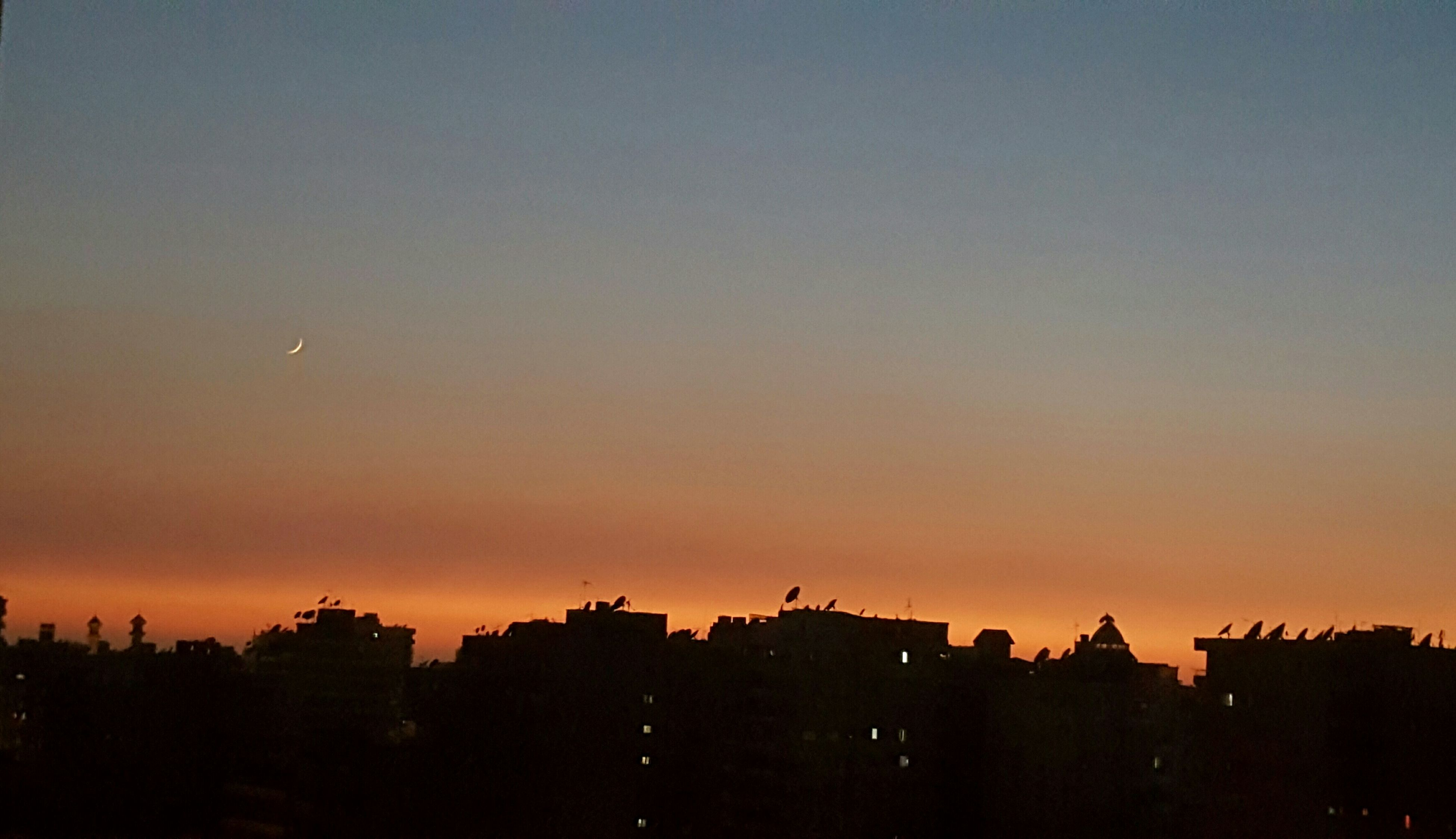 sunset, architecture, built structure, building exterior, silhouette, sky, no people, outdoors, city, nature, tree, cityscape, beauty in nature, day