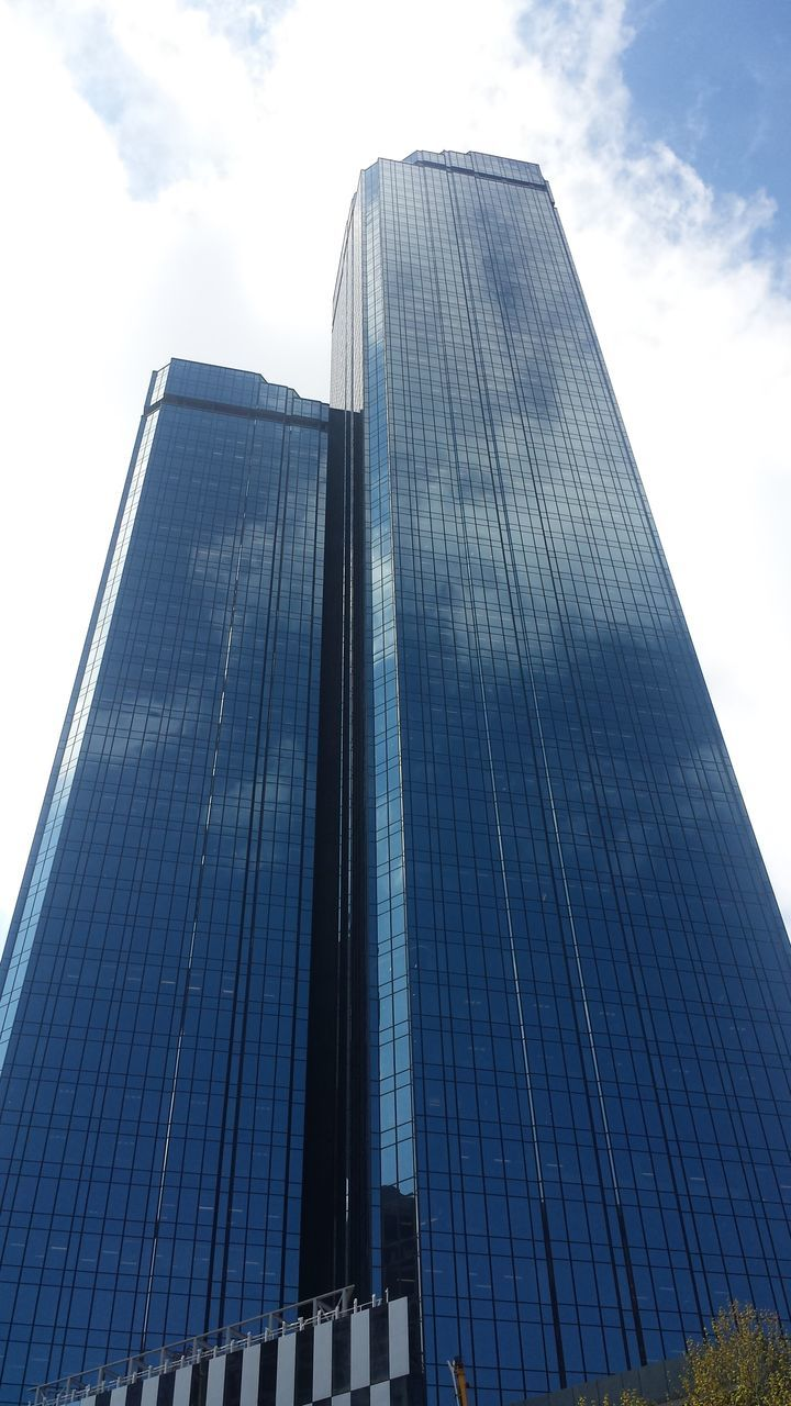 low angle view, architecture, built structure, skyscraper, modern, sky, building exterior, tall, day, no people, outdoors, city, travel destinations