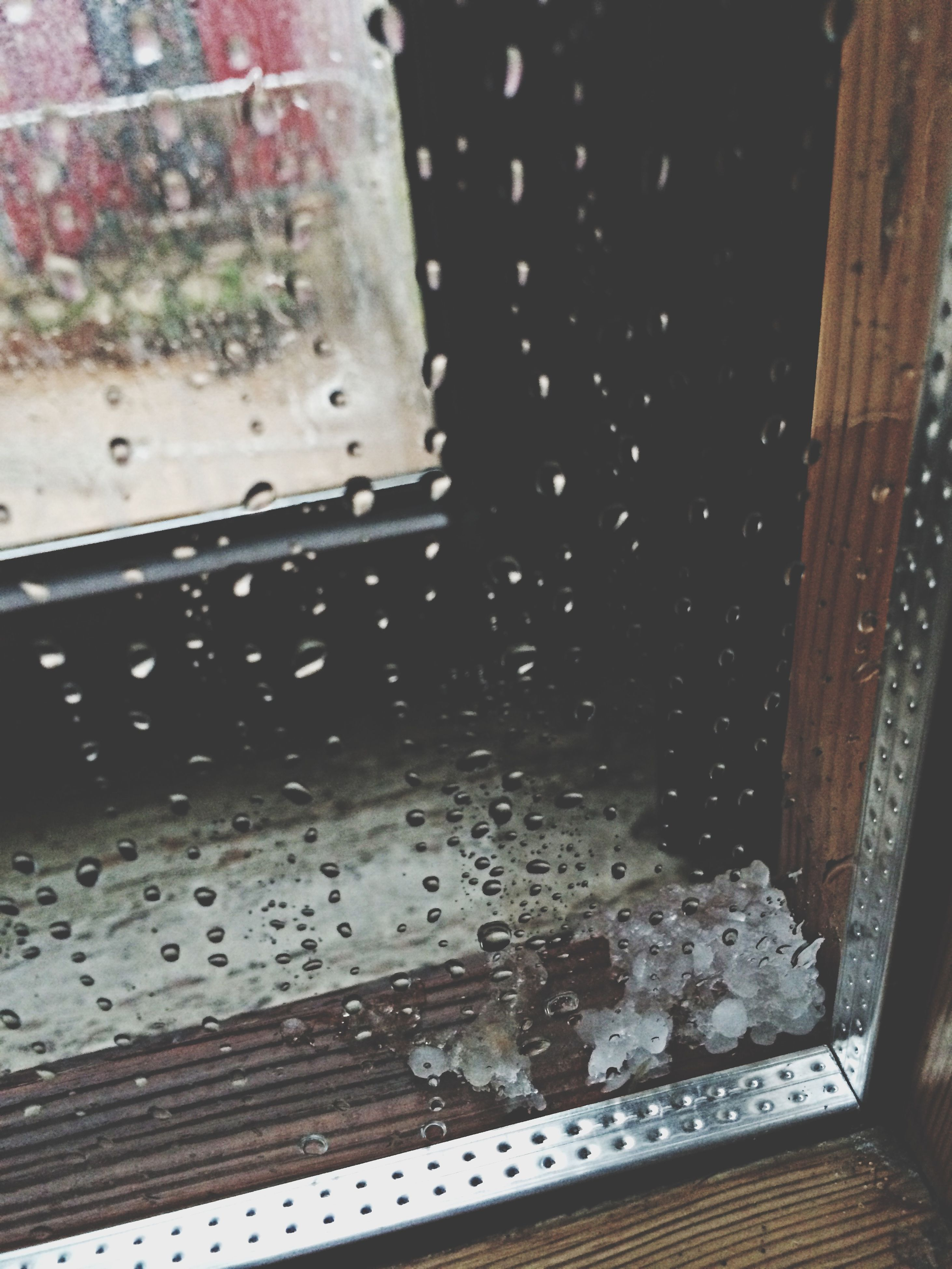 window, indoors, glass - material, wet, season, drop, transparent, rain, water, architecture, built structure, weather, building exterior, glass, raindrop, cold temperature, close-up, no people, day, full frame