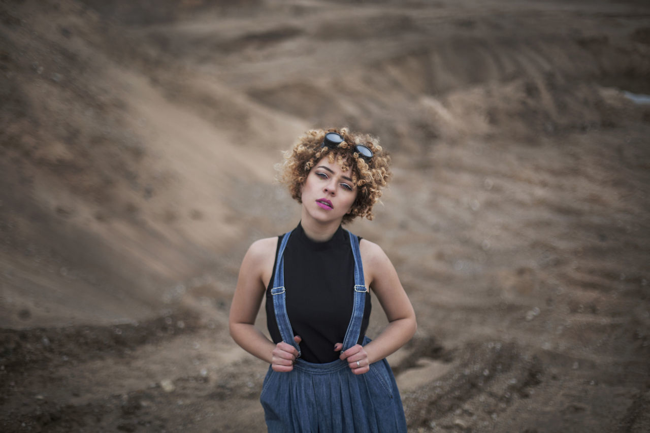 one person, young adult, blond hair, sand, portrait, real people, outdoors, one young woman only, people, day, curly hair, adult, adults only