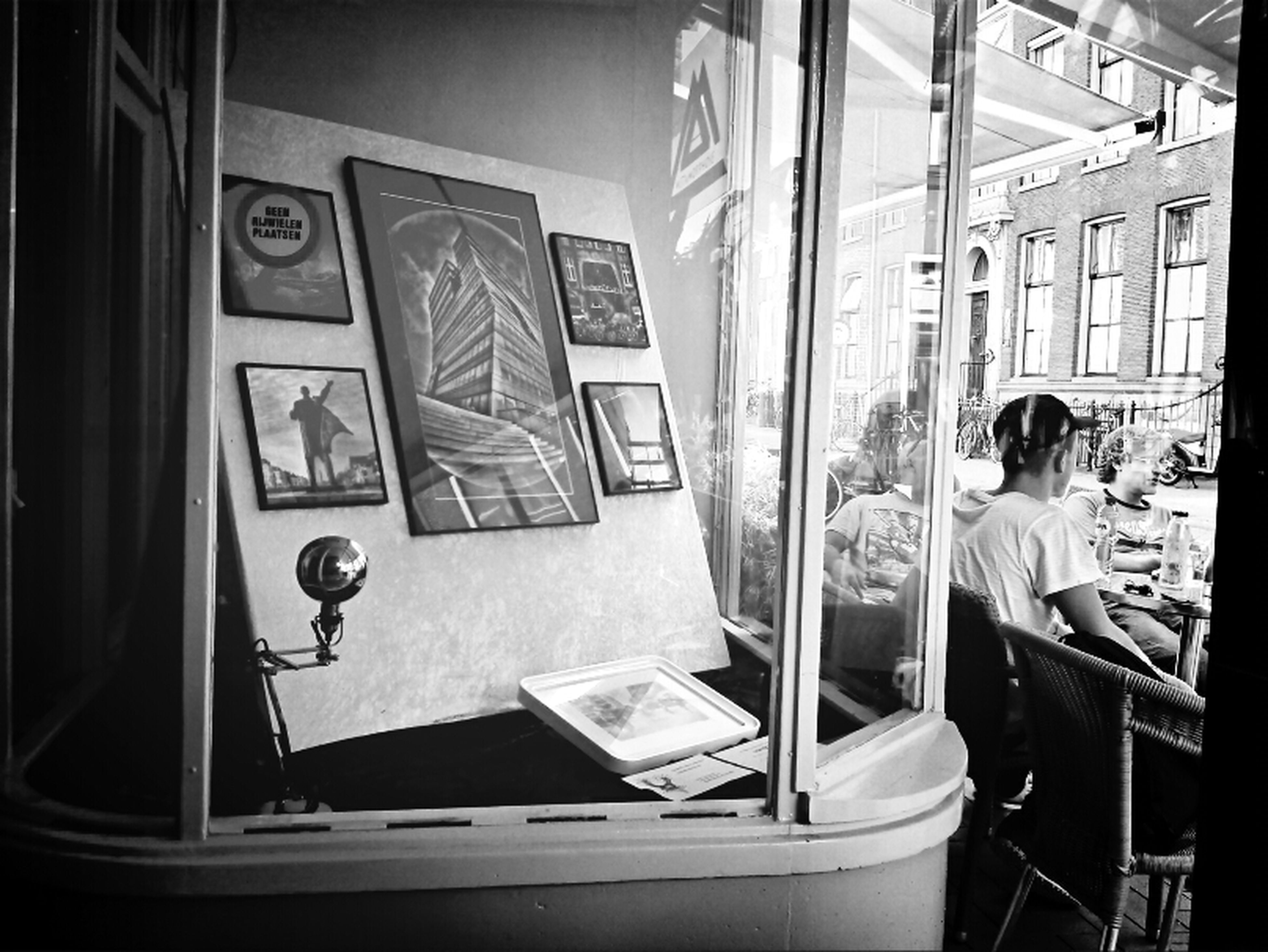 indoors, window, men, lifestyles, technology, sitting, leisure activity, communication, casual clothing, person, transportation, public transportation, day, rear view, glass - material, mode of transport, incidental people