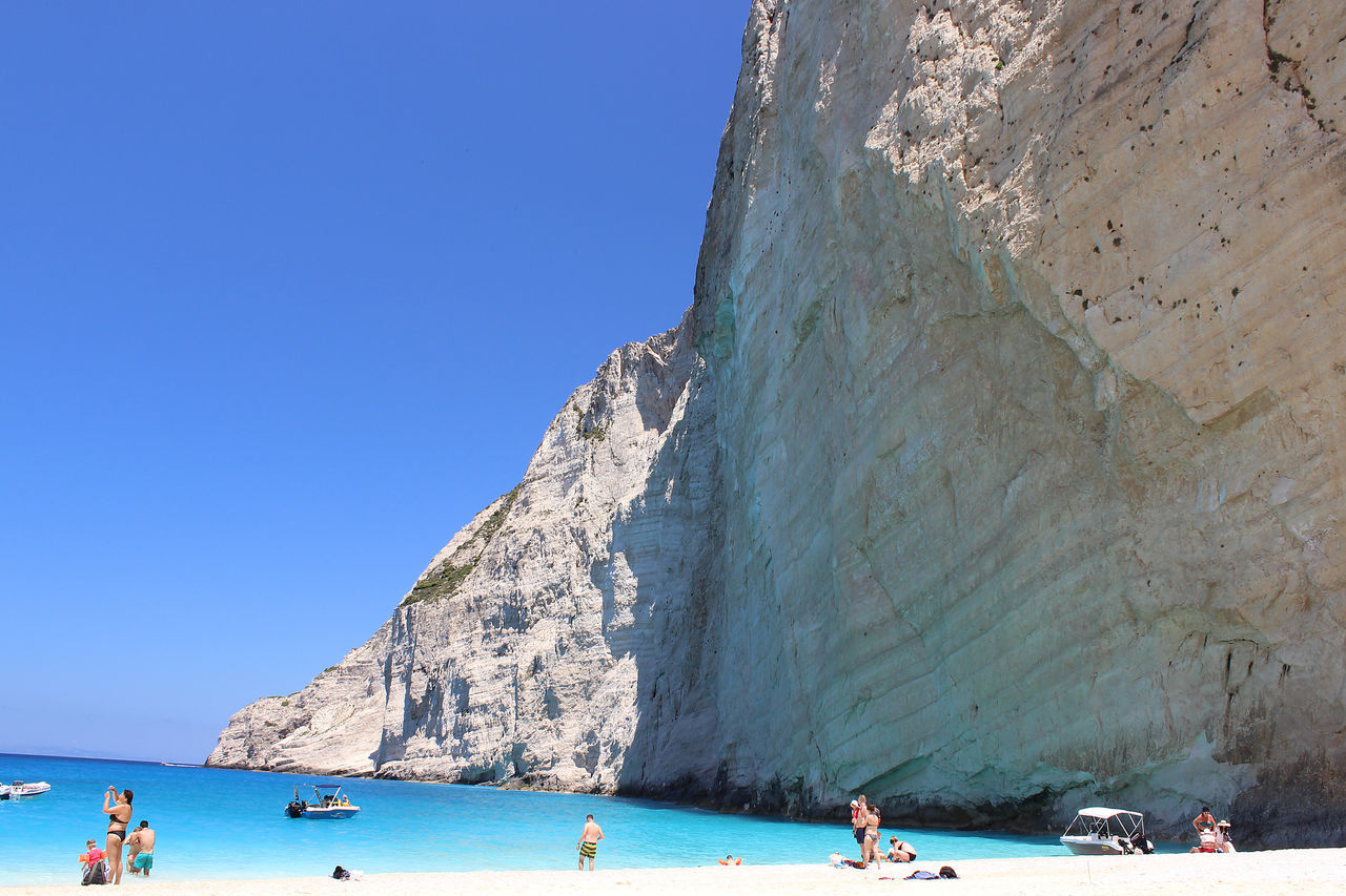 Beach Sea Water Paradise Landscape Holiday Blue Sailing Travel Island Greece Islands Greece Electric Blue Color Sailboat Port Zakinthos Zakynthos,Greece Paradise Island Zakynthos, Greece Paradise On Earth Zakynthos Greece Photos Travel Destinations Greece Memories Clear Sky