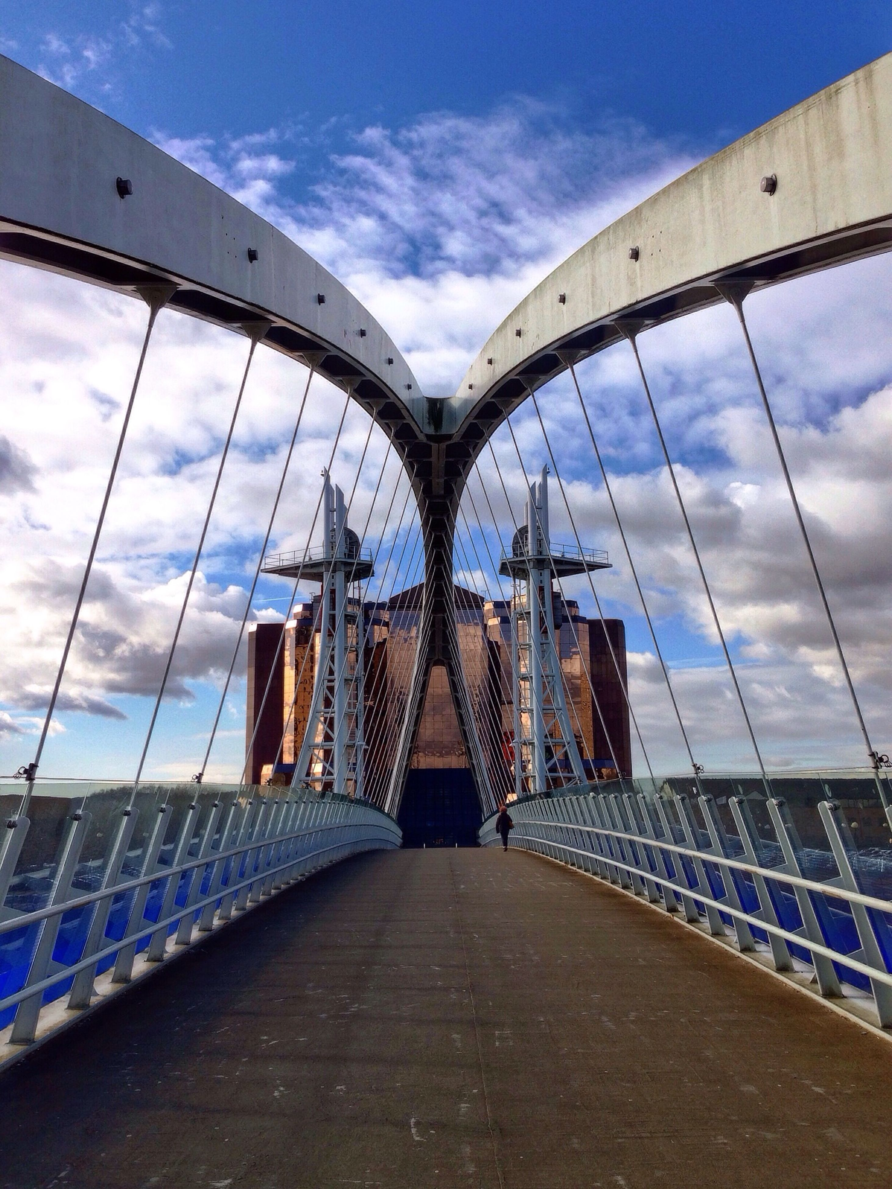architecture, built structure, the way forward, sky, arch, diminishing perspective, bridge - man made structure, building exterior, connection, cloud - sky, cloud, vanishing point, engineering, blue, day, bridge, long, walkway, transportation, city
