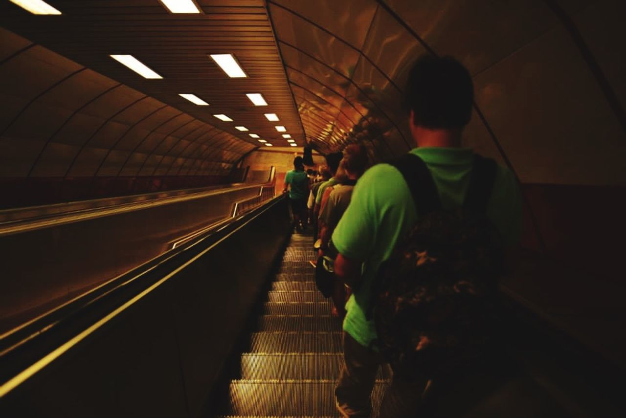 indoors, illuminated, real people, rear view, men, transportation, public transportation, three people, subway station, women, lifestyles, leisure activity, togetherness, standing, full length, technology, day, adult, people