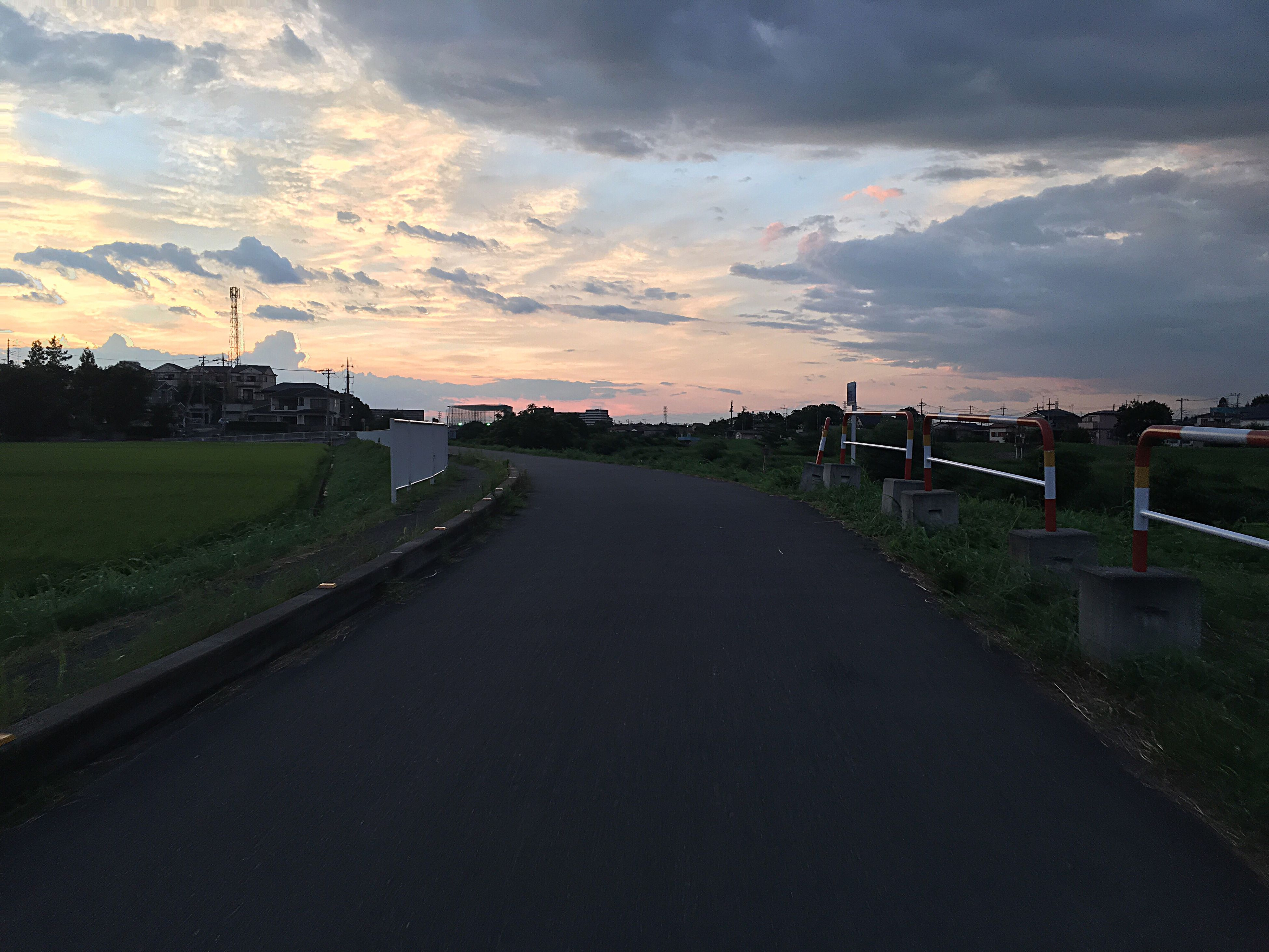 the way forward, sunset, road, empty, sky, cloud - sky, landscape, transportation, long, tranquil scene, cloud, scenics, diminishing perspective, tranquility, empty road, field, orange color, beauty in nature, outdoors, narrow, cloudy, solitude, dark, vanishing point, nature, countryside, remote, non-urban scene, no people, country road, rural scene