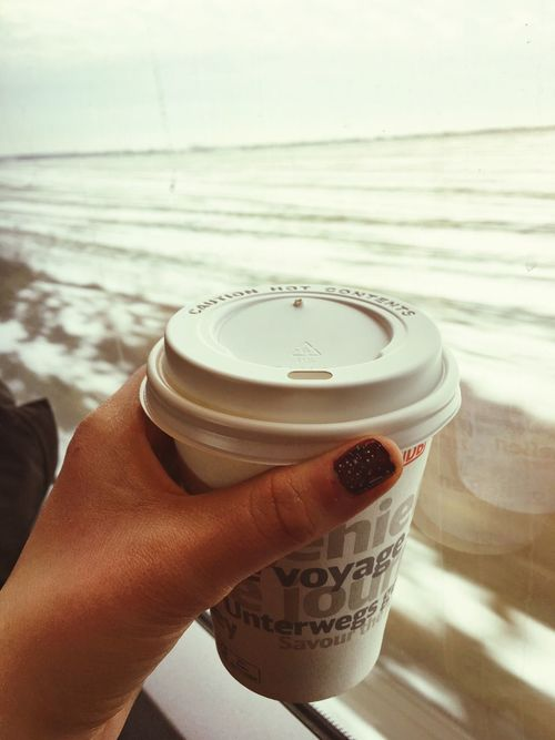 Traveling in a train and having some coffee Human Hand Holding Human Body Part Drink Focus On Foreground Food And Drink Real People Close-up One Person Beach Refreshment Disposable Outdoors Lifestyles Disposable Cup Day Men Freshness Frothy Drink Woman Hand Beverage Cup Hold Traveling