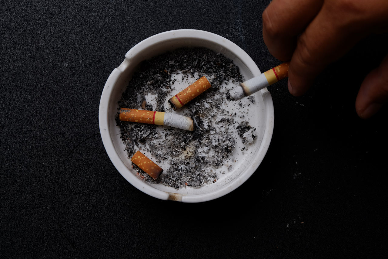 Addiction Adult Adults Only Ashtray  Bad Habit Cigarette  Cigarette Butt Cigarette Stubs Close-up Human Body Part Human Hand Indoors  Men One Man Only One Person People Preparation  Smoke - Physical Structure Smoking Issues