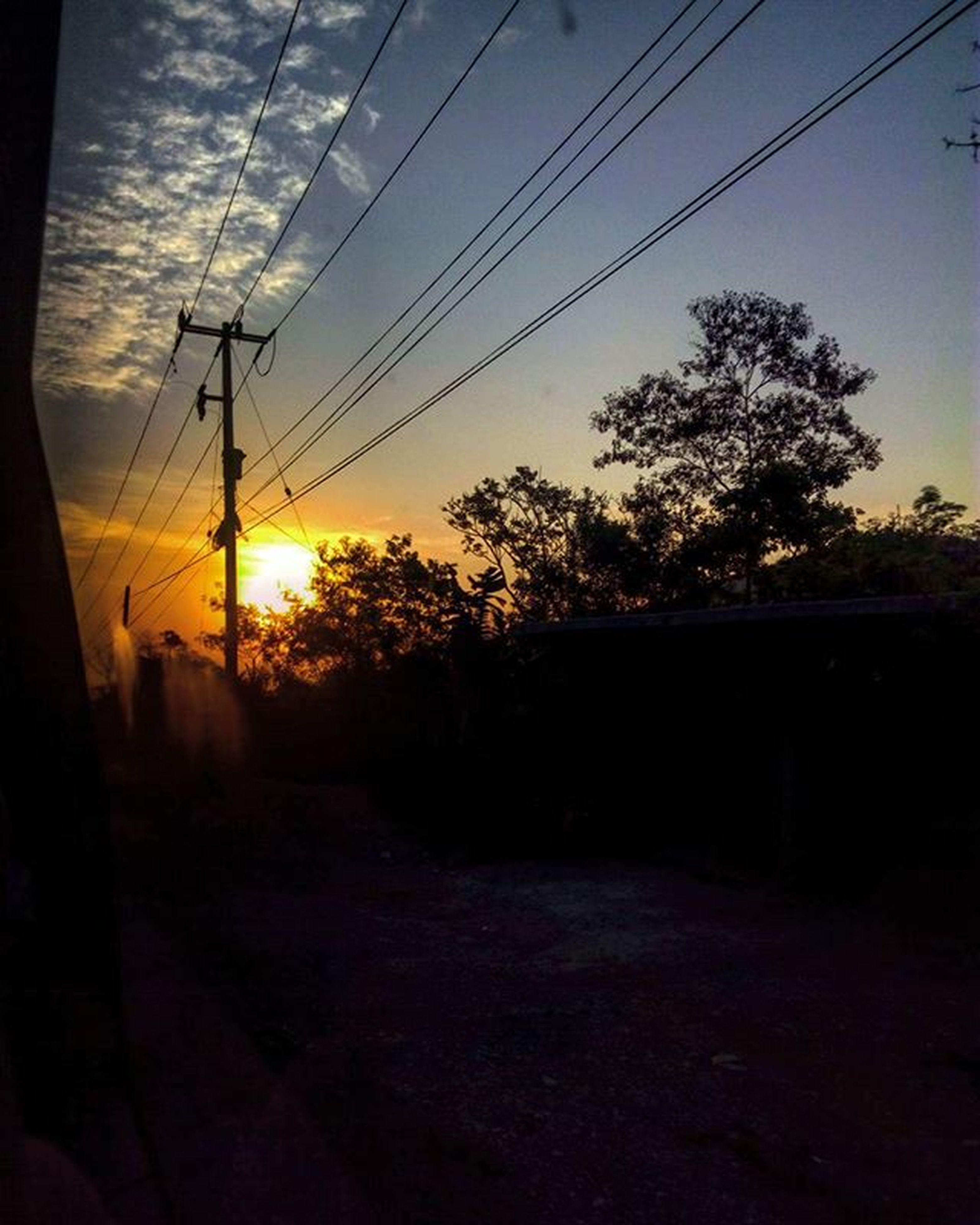 power line, electricity pylon, electricity, power supply, cable, sunset, sky, silhouette, transportation, connection, tree, power cable, fuel and power generation, road, sunlight, sun, nature, street, no people, the way forward