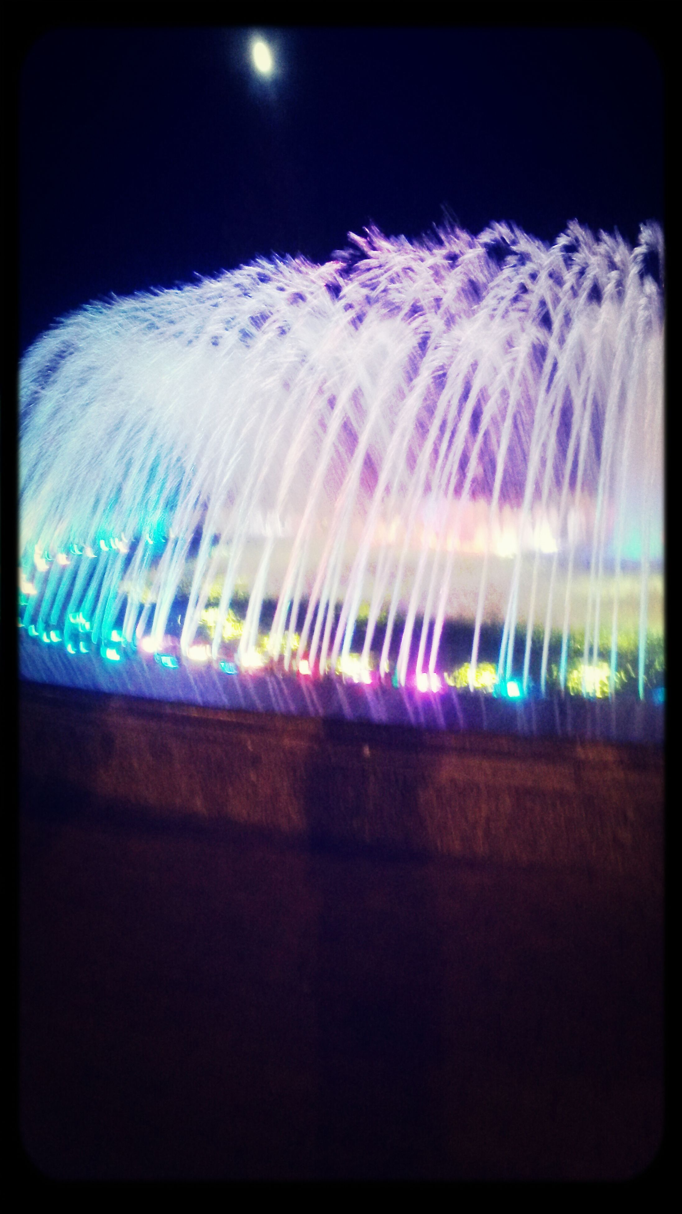 illuminated, night, long exposure, motion, transfer print, auto post production filter, blurred motion, multi colored, blue, glowing, light trail, arts culture and entertainment, light - natural phenomenon, light, lighting equipment, speed, water, no people, abstract, celebration