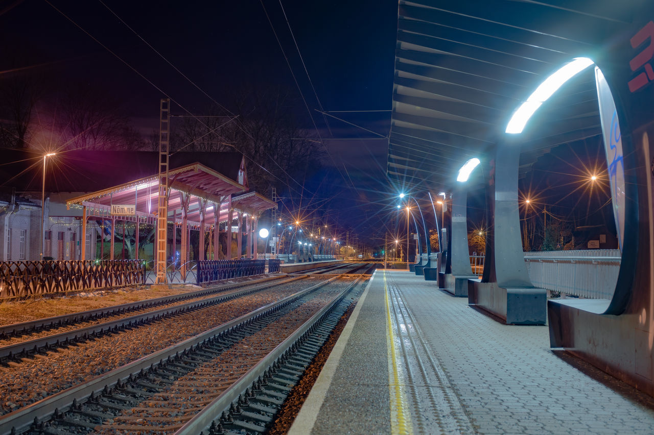 city lights, railway station in Tallinn, Estonia Architecture Built Structure Business Finance And Industry City Illuminated Night No People Nõmme Outdoors Railroad Track Railway Station Railway Station Platform Railway Track Road Tallinn Transportation