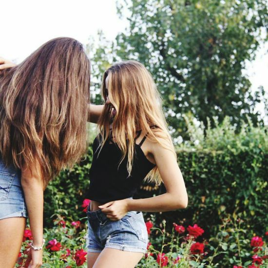 Ecuador Two People Togetherness Adult Flower Summer People Young Women Casual Clothing Women Only Young Women Young Adult Long Hair Smiling Outdoors Friendship Day Love Bonding Child Leisure Activity