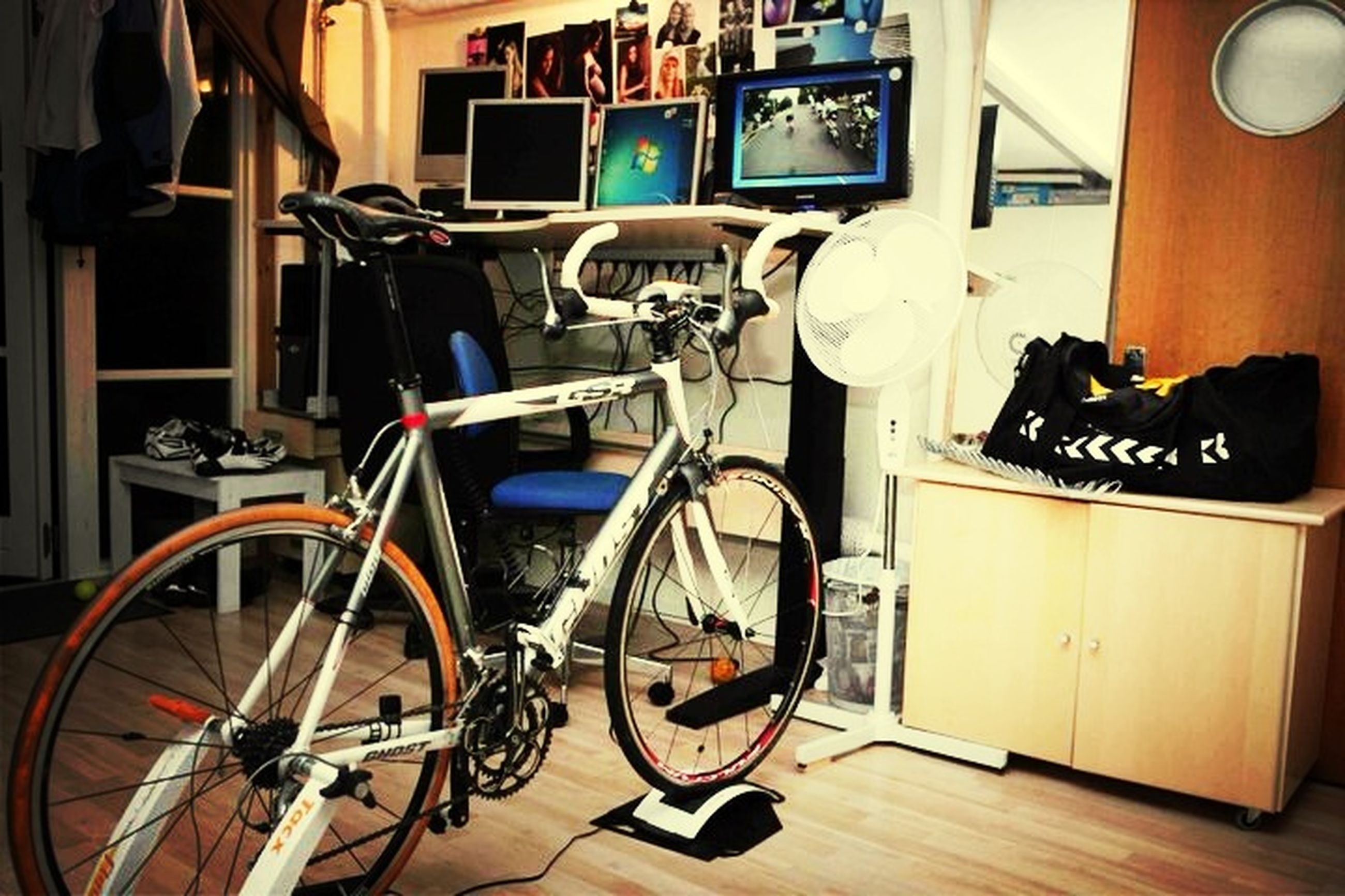 bicycle, mode of transport, transportation, land vehicle, parking, stationary, parked, built structure, architecture, indoors, building exterior, table, parking lot, no people, house, absence, car, street, motorcycle, chair
