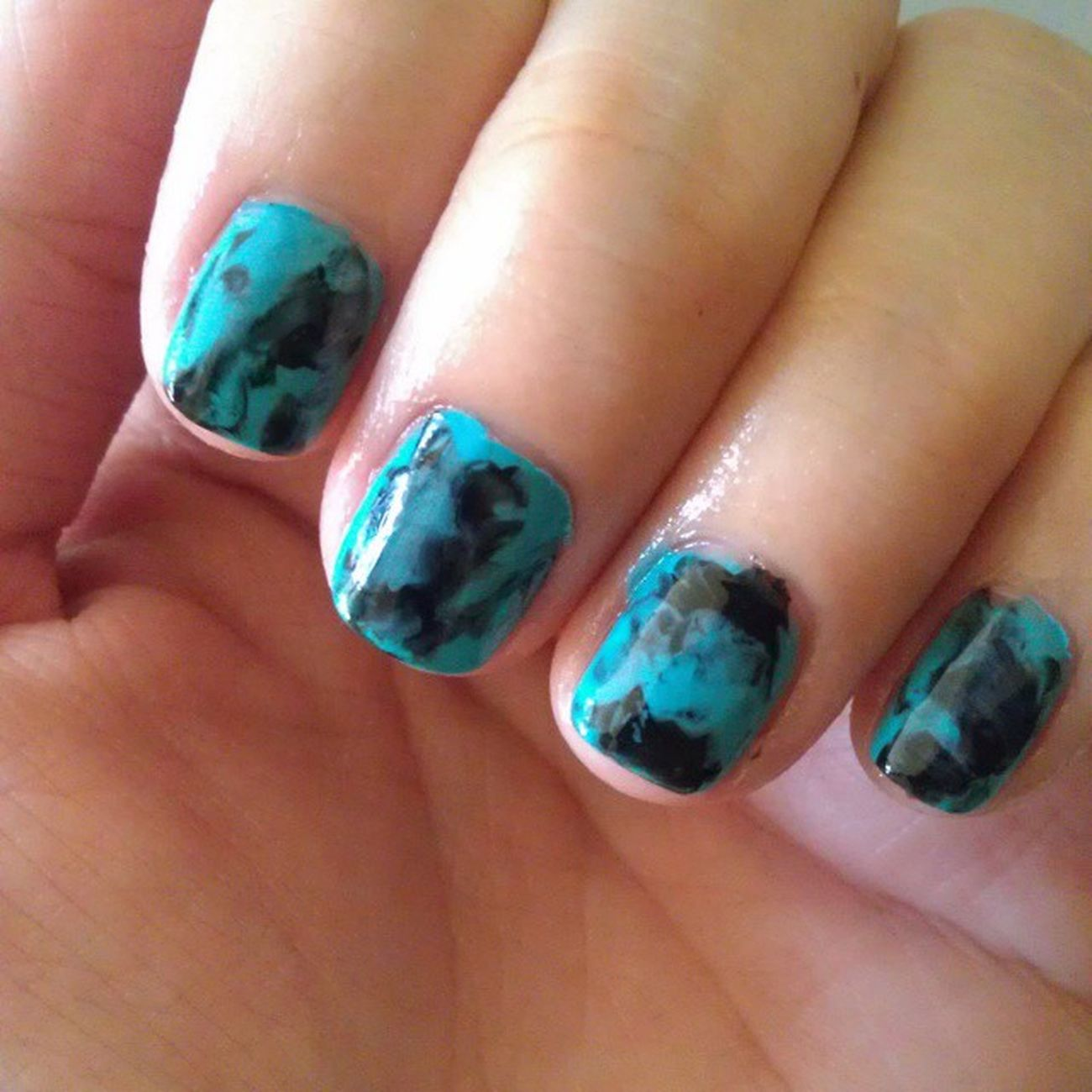 Love this! Its Saranwrapmani made with cyan and black polish! Happynails Cyan Black