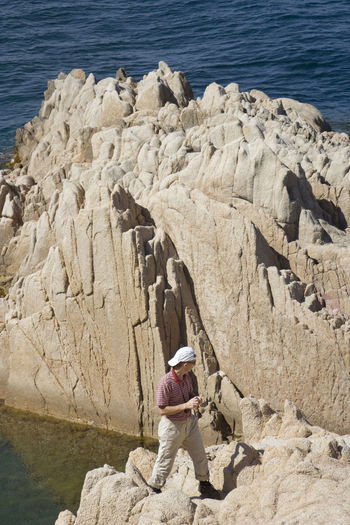 man on cliffs - gulf of saint-tropez, French Riviera Adventure Beauty In Nature Casual Clothing Cliff Climbing Côte D'Azur France Full Length Gulf Of Saint-tropez High Angle View Hiking Hiking Hikingadventures Man Mediterranean Sea Nature One Man Only People Provence Rock Rock Formation Rocky Coastline Saint-Tropez Taking Photos Vacations