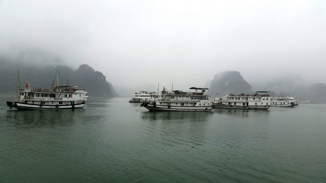 Beautiful stock photos of boote, Boat, Day, Foggy, Haiphong