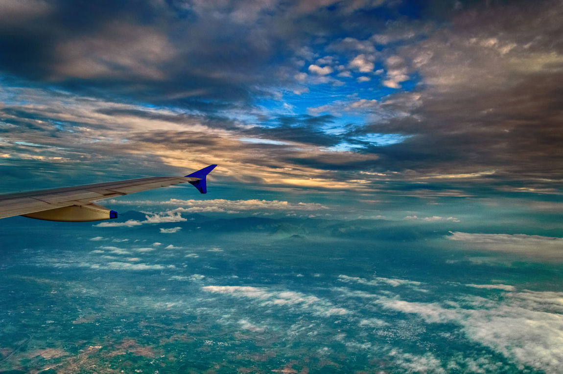 View of Dawn Sky from the Plane Good Morning World! Aerial View Airplane Airplane Wing Beauty In Nature Blue Cloud - Sky Dawn Of A New Day Day Flying Horizon Over Water Nature One Person Outdoors People Real People Scenics Sea Sky Sunset Tranquil Scene Tranquility Transportation Vacations Water