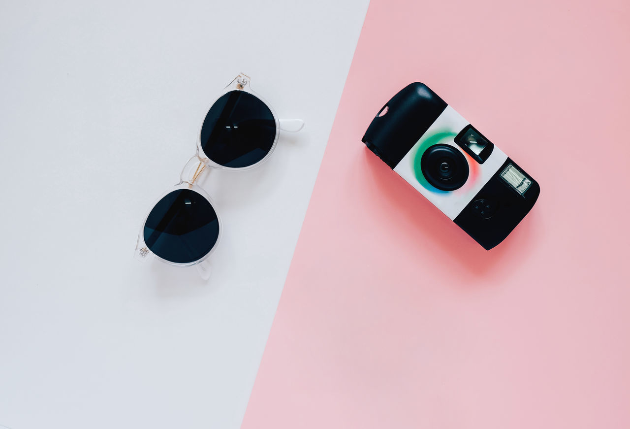 Camera Close-up Colorful Creative Day Design Fashion Flat Lay Indoors  Minimal No People Objects Photography Pink Still Life Studio Shot Sunglasses Table Technology Top View Travel Items
