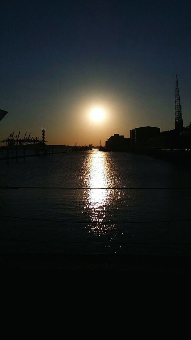 Water Sun Sunset Building Exterior Built Structure Silhouette Architecture Reflection Scenics City Tranquil Scene Tranquility Sky Sea Outdoors Calm Nature Beauty In Nature No People Back Lit Life 2016 Illuminated Harbour Life Transportation