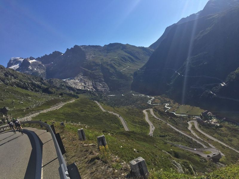 Grimsel pass looking to Furka pass in distance with cyclists Grimsel Grimselpass Furka Furkapass Cycling Cyclist Cyclists Alps Switzerland Mountains Mountain Hairpin Hairpin Turns Switchback Epic Sportif Sport Sports