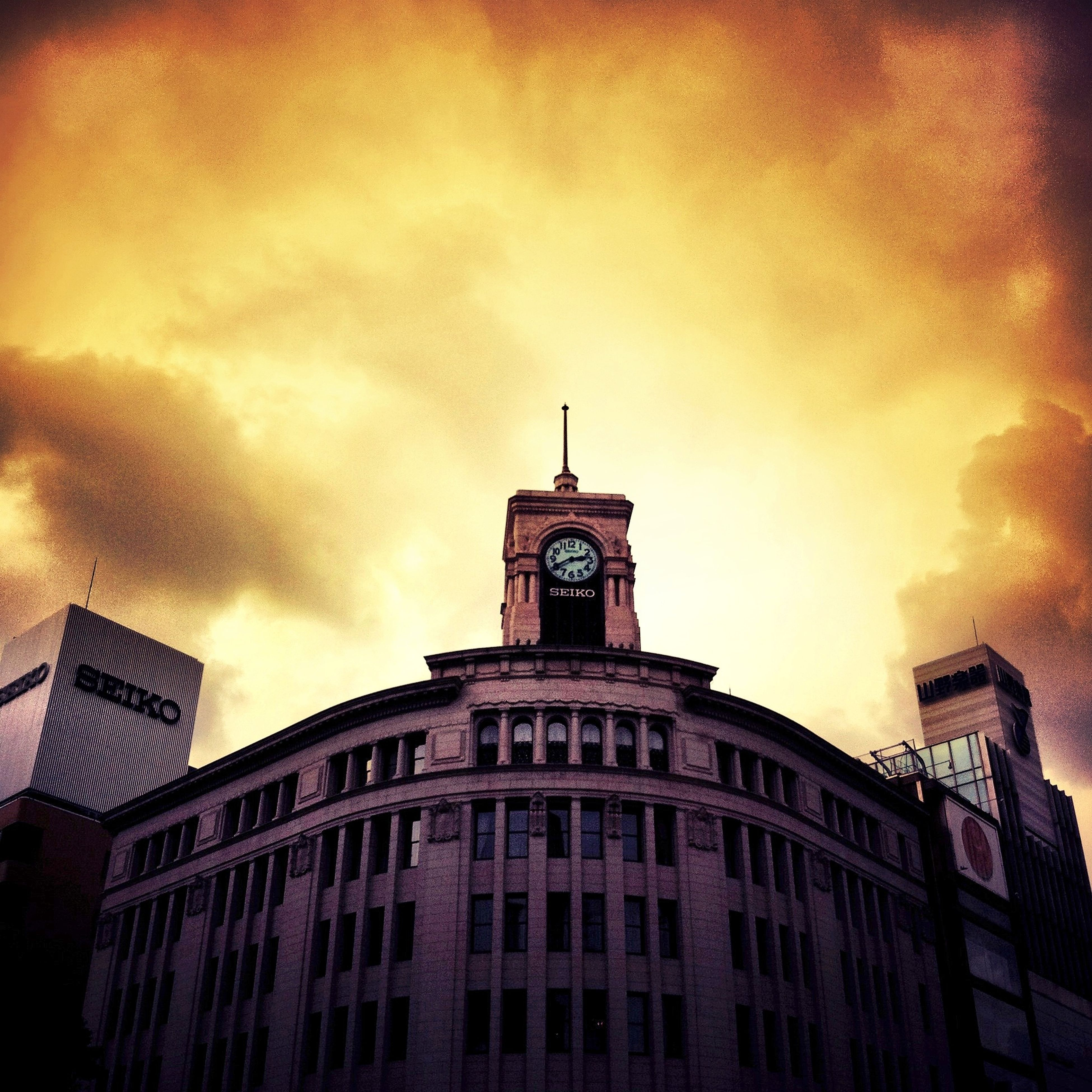 building exterior, architecture, built structure, low angle view, sky, cloud - sky, city, sunset, building, cloudy, high section, cloud, window, outdoors, tower, no people, orange color, residential building, dusk, residential structure