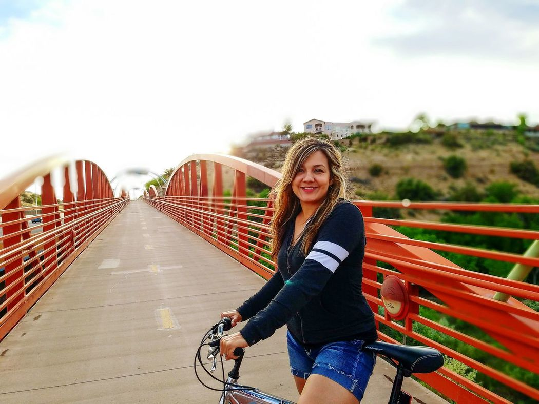 The Great Outdoors - 2017 EyeEm Awards The Street Photographer - 2017 EyeEm Awards The Architect - 2017 EyeEm Awards The Portraitist - 2017 EyeEm Awards Adult One Woman Only Love Her! The Wifey  Casual Clothing Lifestyles Sky Near Focus Hillside View Bridge Over The River Río Grande River Albuquerque New Mexico Bike Ride Fresh Air And Sunshine Healthychoices Smiling Beauty Outdoors Enjoying Life Hello World Samsung Galaxy S7 Edge