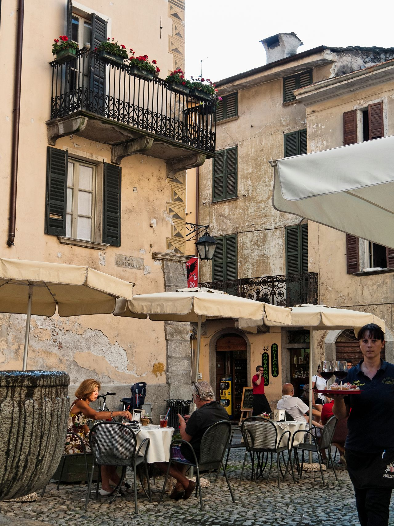 Adult Adults Only Architecture Balcony Building Exterior Built Structure City Day Food And Drink Industry Men Old Town One Person Outdoors People Sidewalk Cafe Sky Table Window