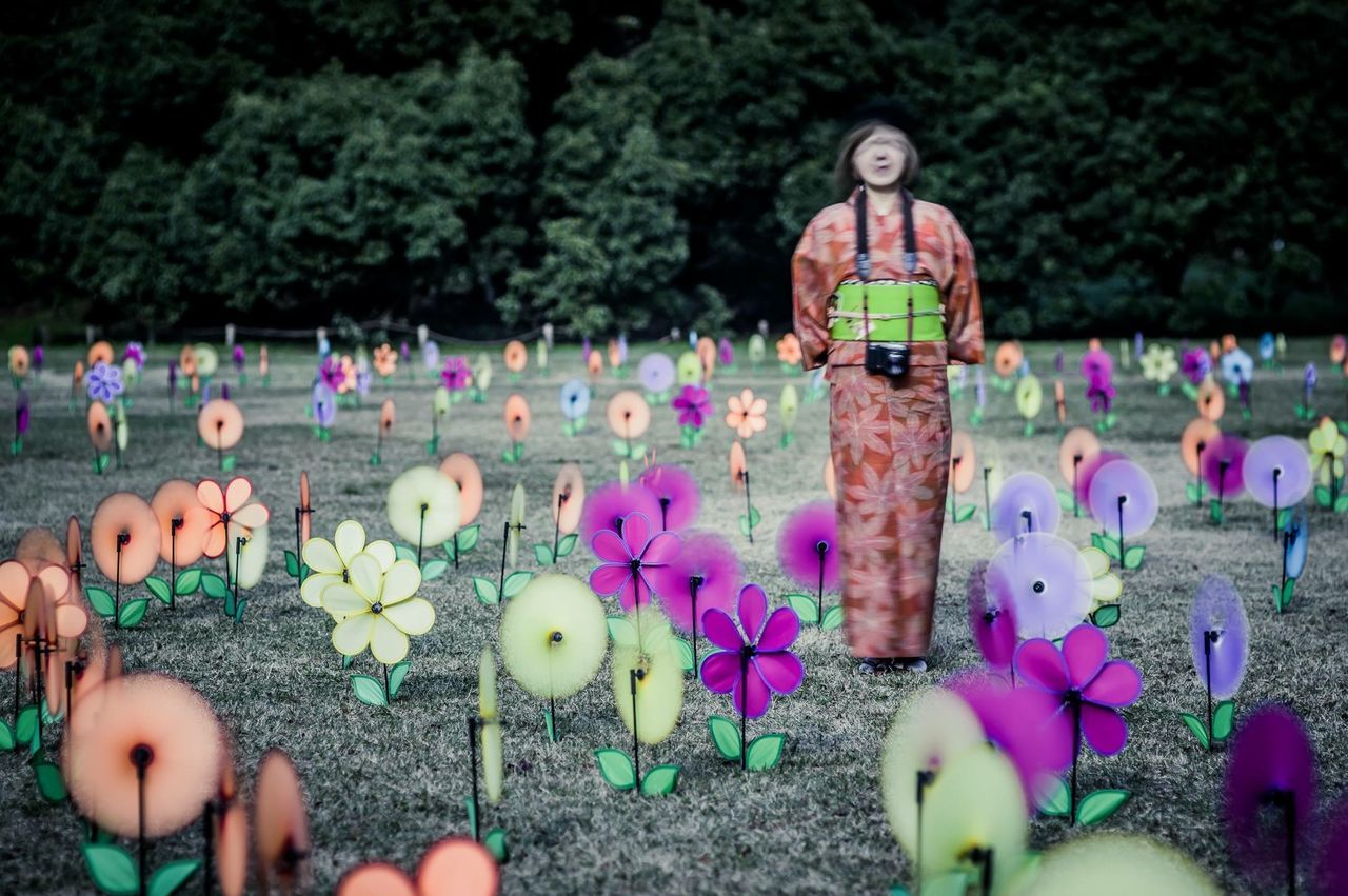 human representation, art and craft, creativity, art, flower, multi colored, animal representation, toy, focus on foreground, childhood, statue, standing, celebration, outdoors, leisure activity, figurine