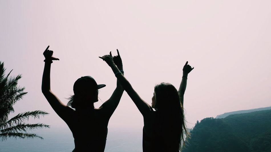 Silhouette Togetherness Leisure Activity Bonding Lifestyles Love Friendship Person Enjoyment Gesturing Peace Sign  Fun Outdoors Creativity Hawaii