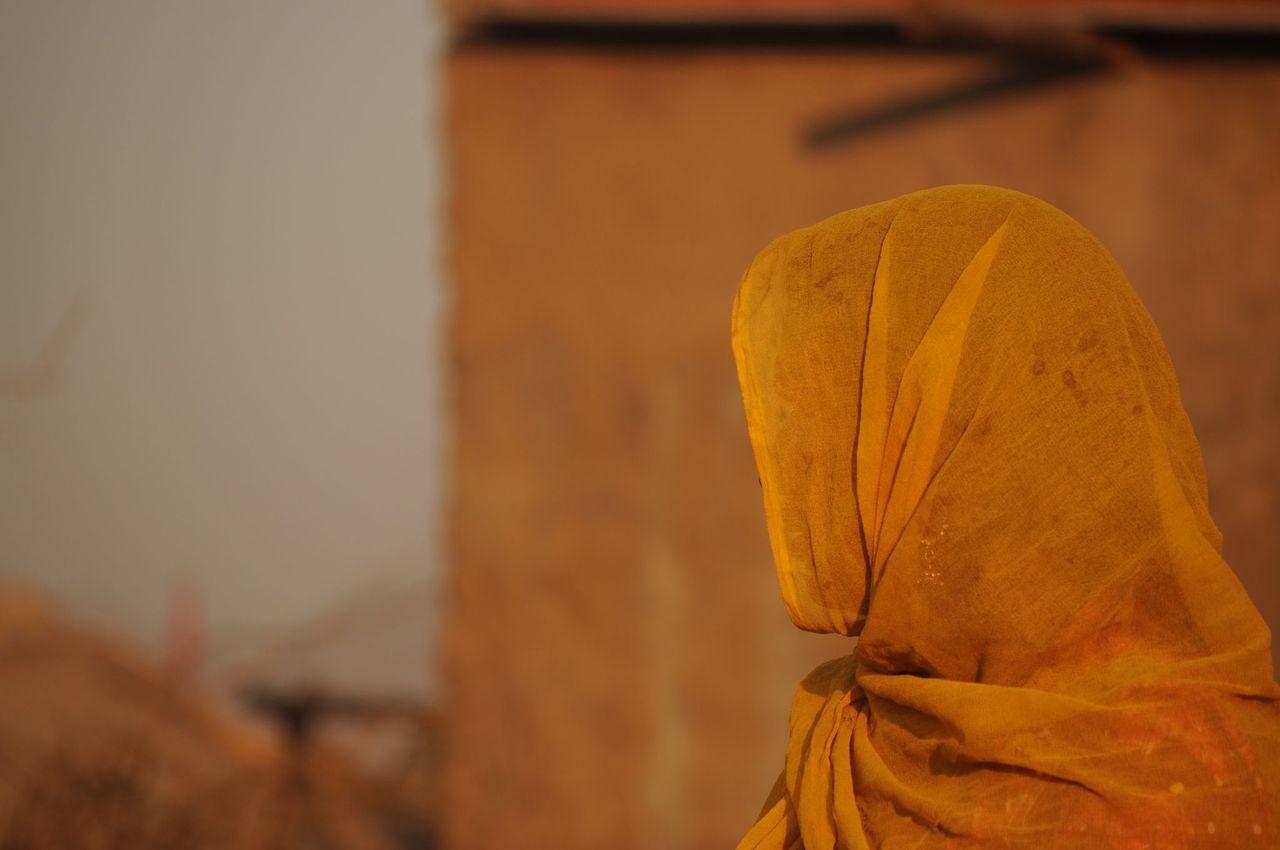 Woman In Yellow Veil Looking Away