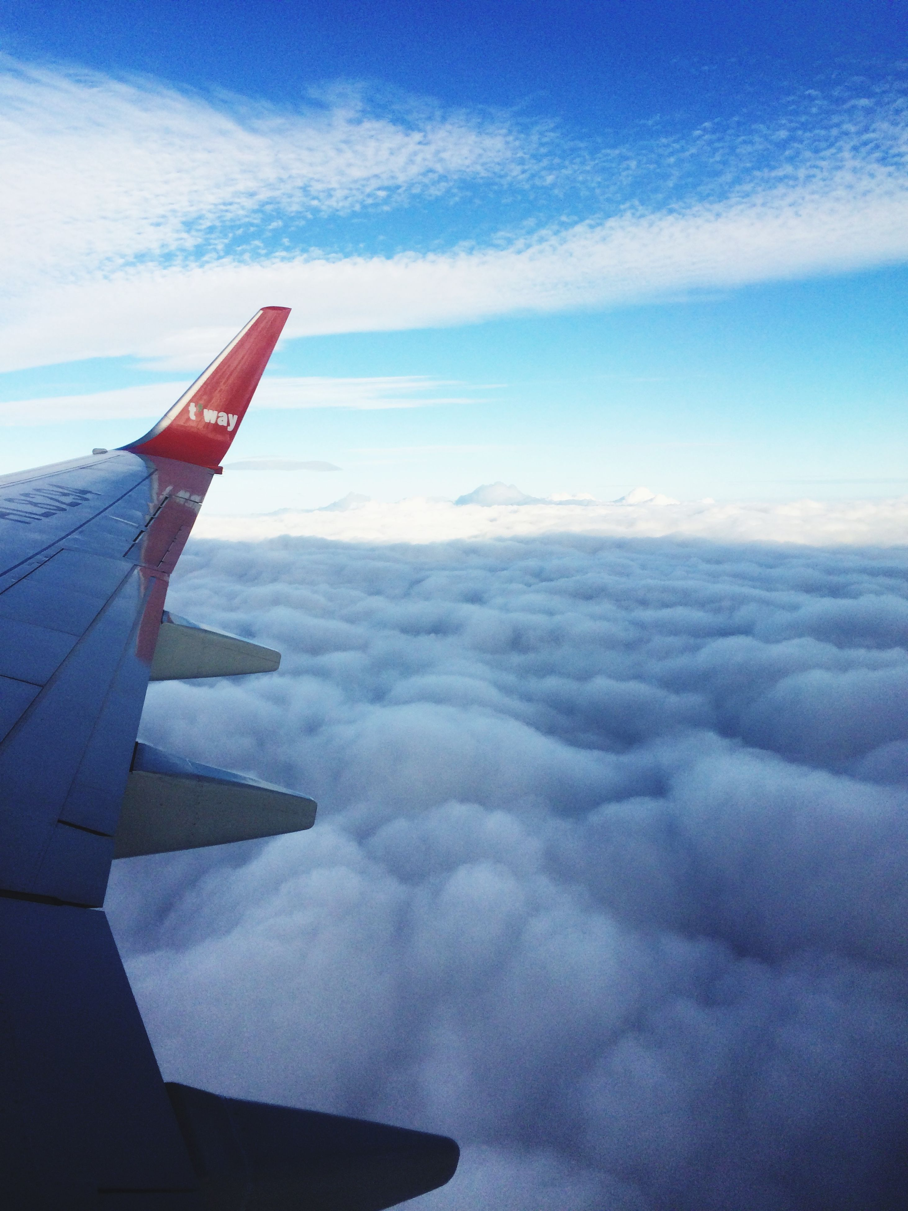 aircraft wing, airplane, air vehicle, transportation, sky, part of, mode of transport, flying, cropped, aerial view, cloud - sky, scenics, beauty in nature, mid-air, travel, cloud, nature, cloudscape, journey, tranquility