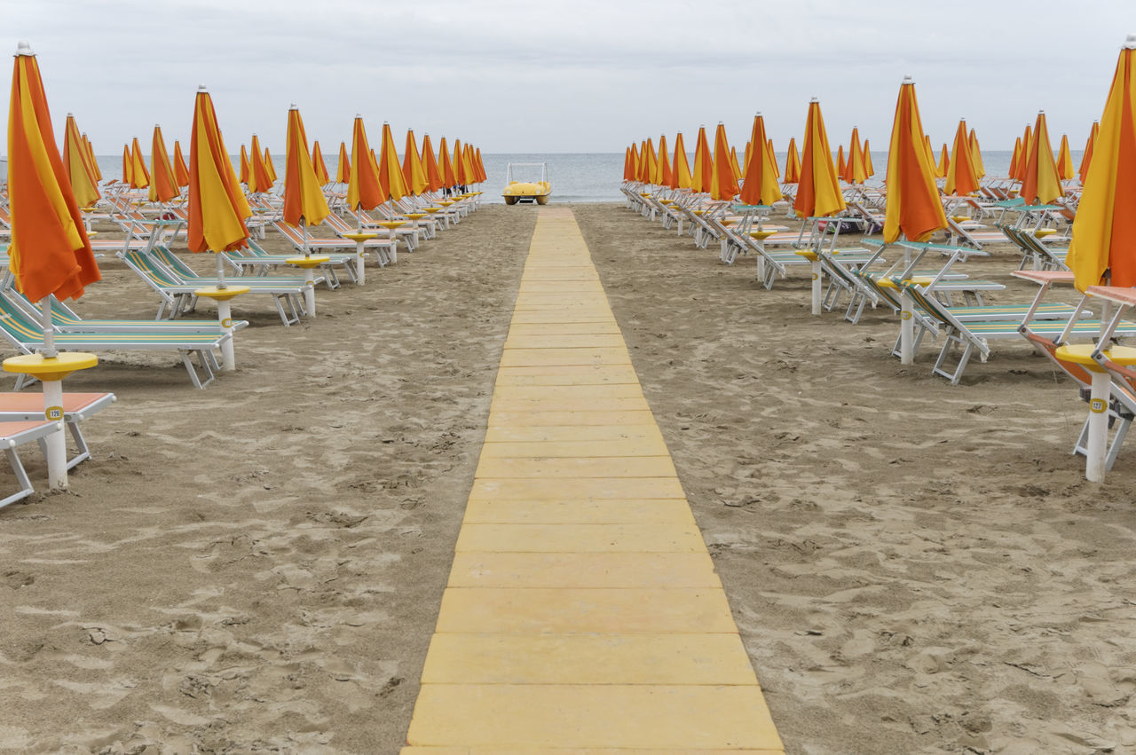 end of season, Emilia Romagna coast, Italy Absence Adriatic Beach Boardwalk Coast Deserted Emilia Romagna Empty End Of Season  End Of Summer In A Row Italy Off Season Parasol Parasols Rescue Boat Sandy Seaside Sunbeds Sunshade Sunshades Tranquility Vacations Walkway