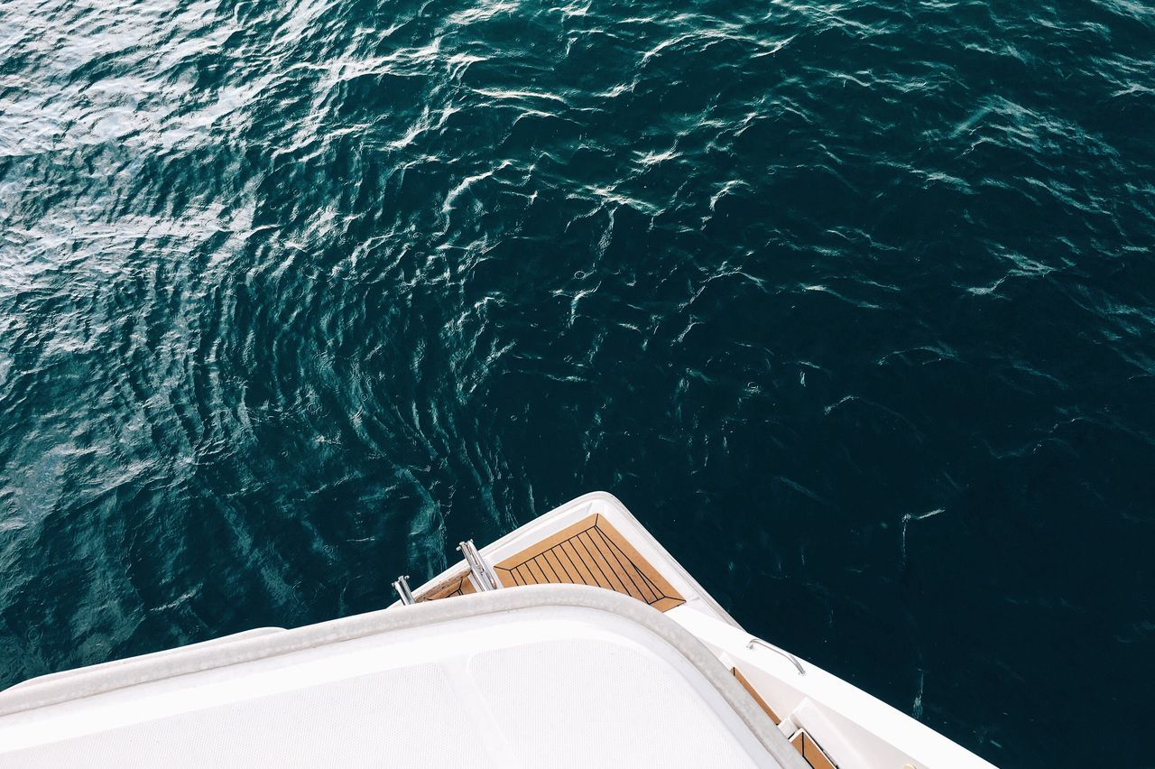 Cropped Image Of Boat Sailing On Sea