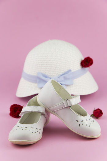 Baby Girl Close-up Cut Out Flower Flowers Fragility Hat Little Girl No People Petal Pink Pink Color Ribbon Roses Schoes Still Life Studio Shot Two Objects White White Background White Color