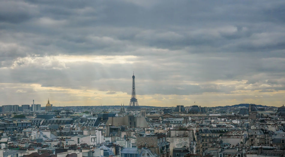 Small Eiffel Tower at horizon in France with sprawling urban landscape in foreground Aerial Architecture Architecture City Cloudscape Eiffel France Horizontal La Tour Eiffel Landmark Nature No People Outdoors Panorama Panoramic Paris Rooftops Top Tower Wide-angled