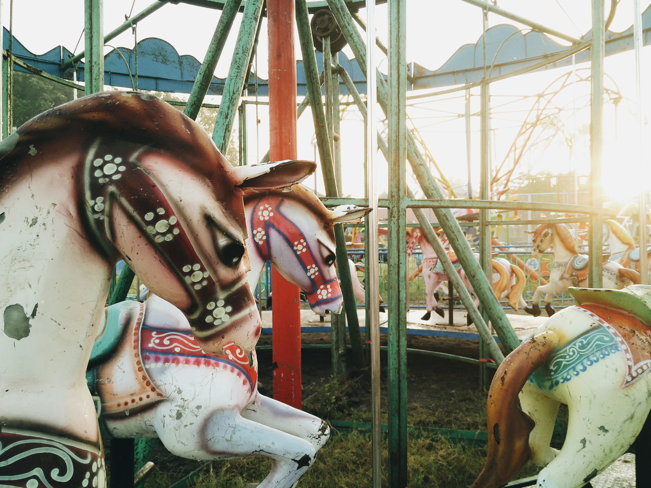 amusement park, horse, carousel horses, carousel, amusement park ride, animal representation, arts culture and entertainment, outdoor play equipment, no people, day, merry-go-round, childhood, outdoors, close-up, animal themes