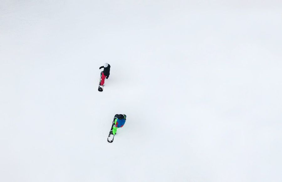 Copy Space White Background Leisure Activity Lifestyles One Person Real People High Angle View Adventure Day Sport Full Length Outdoors Winter Men Ski Holiday Extreme Sports Nature Warm Clothing Snowboarding Sky