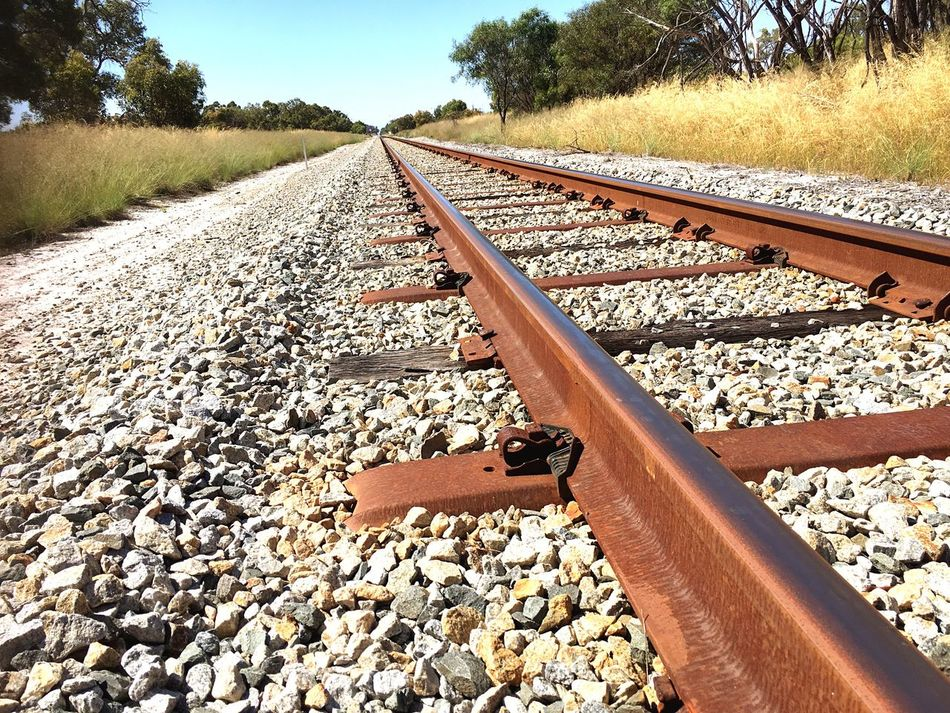 Finding New Frontiers Railroad Track Rail Transportation The Way Forward Transportation Nature Gravel Railway Track Close-up Australia Abstract EyeEm Best Shots Popular Photos Hello World No People Landscape EyeEm Travel Traveling Rail EyeEm Gallery Mission Day Outdoors Tranquility Traveling Home For The Holidays