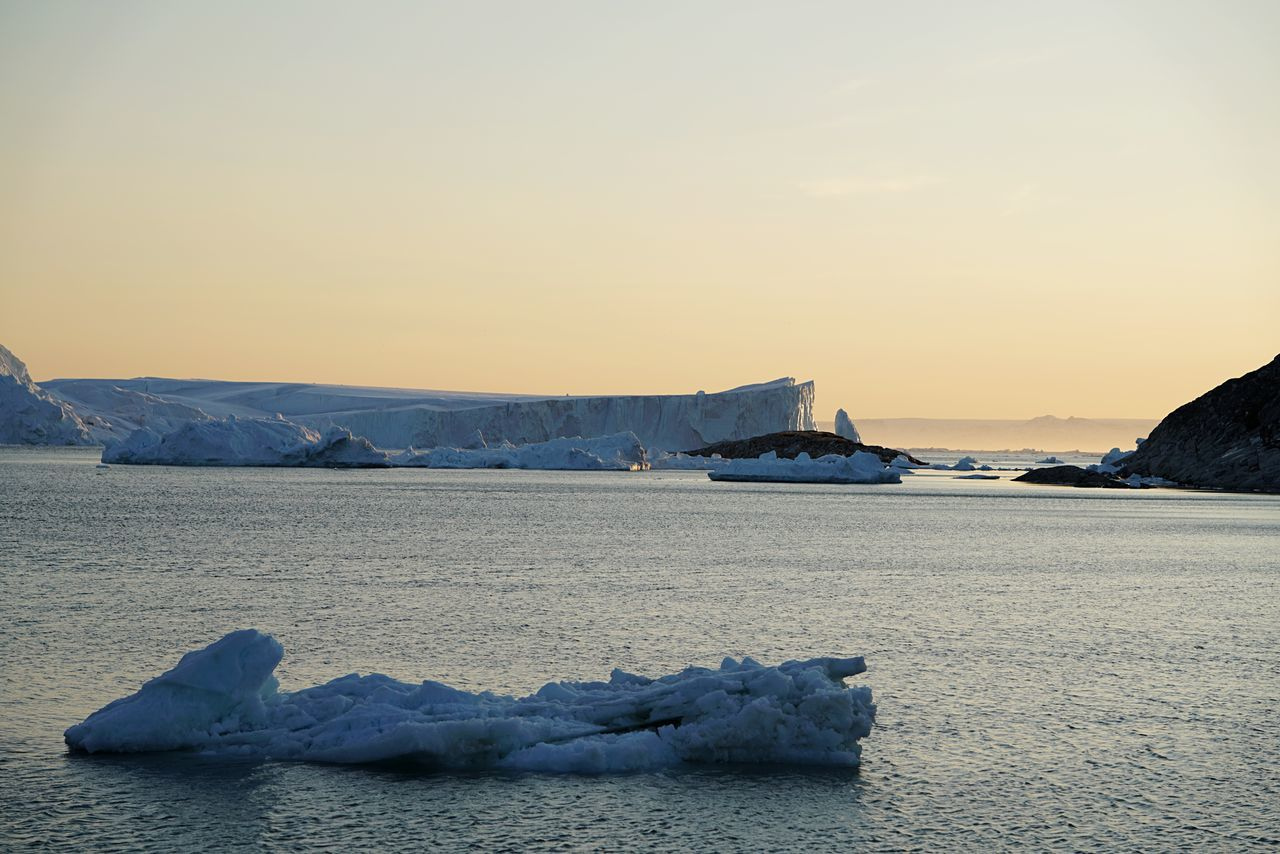 Greenland ıceberg Ice Bergs Greenland EyeEm Selects Beauty In Nature Scenics Nature Sea Tranquility Tranquil Scene Sunset Water No People Winter Cold Temperature Outdoors Sky Ice Snow Clear Sky Frozen