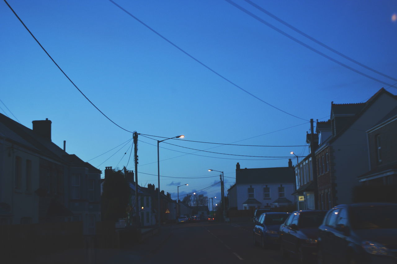 cable, transportation, power line, car, electricity, no people, building exterior, outdoors, clear sky, blue, architecture, electricity pylon, sky, day, nature, city