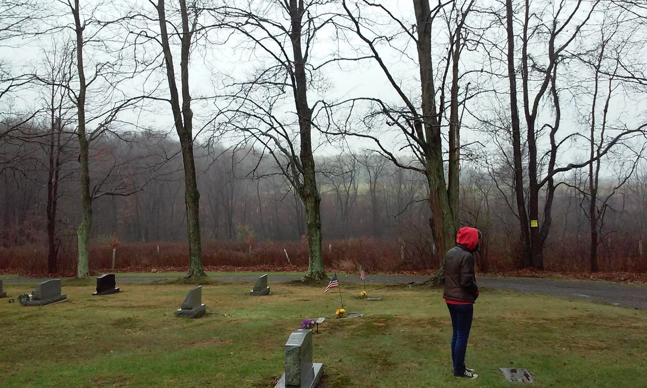 Outdoors Day No Filter Needed No Filter Non-urban Scene Graveyard Graveyard Beauty Grave Tranquility Cloud - Sky Landscape Grass Trees Nature United States Beauty In Nature One Person One Woman Only No Filter, No Edit, Just Photography Red Hoodie Cold Temperature Cold Looking At Ground Gravestone
