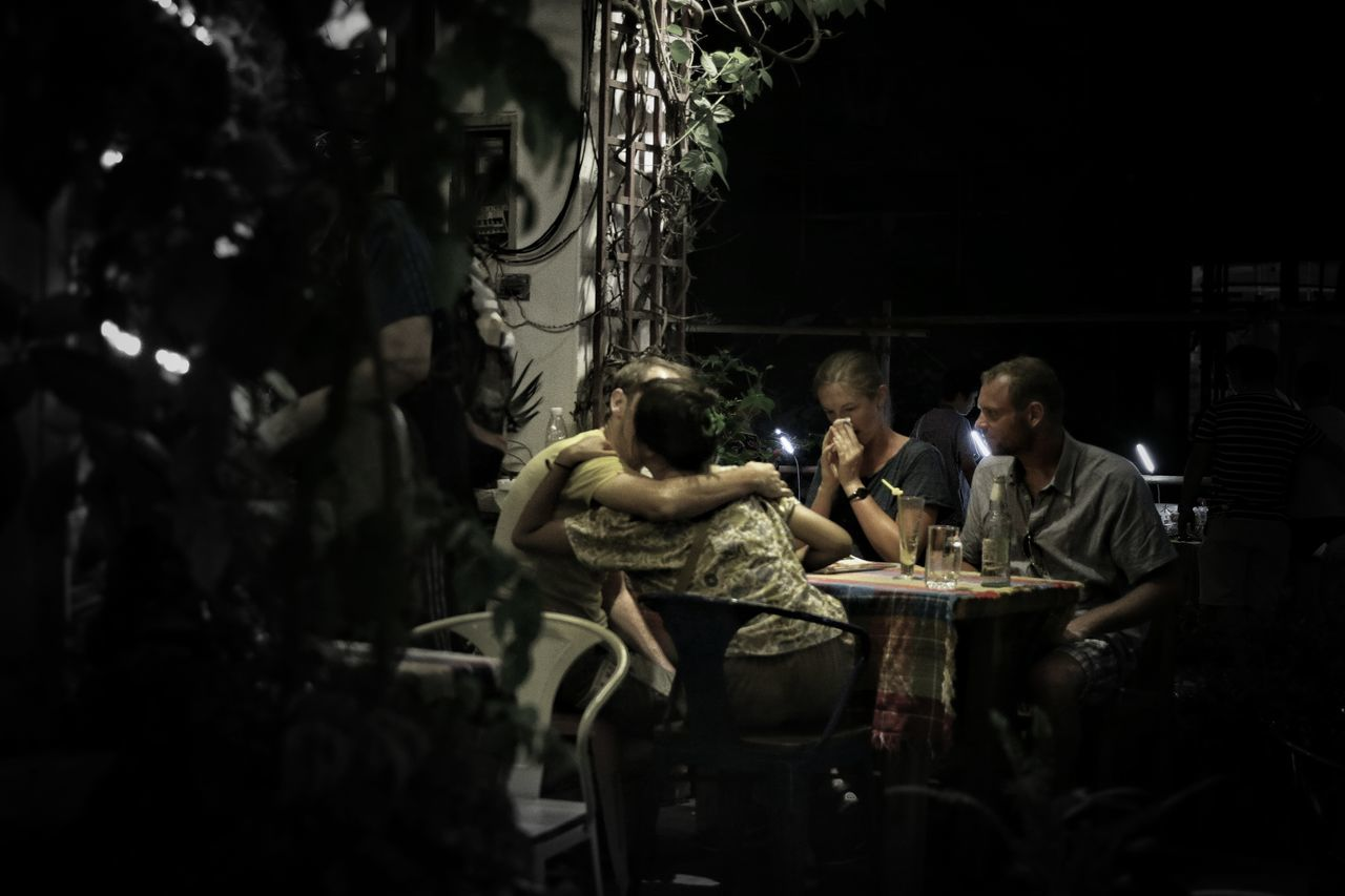 real people, sitting, outdoors, men, night, young adult, people