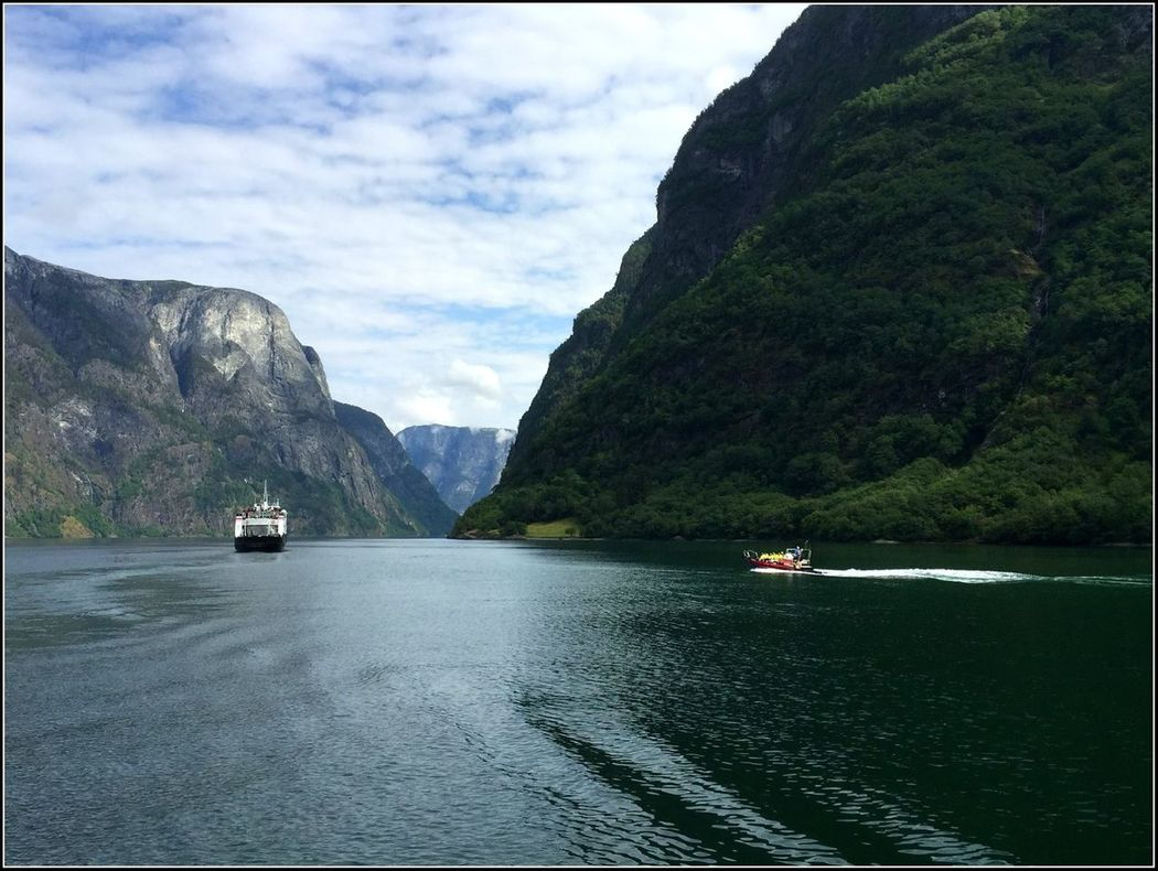 Mountain Nautical Vessel Landscape Travel Destinations Cultures Scenics Beauty In Nature Lake Outdoors Transportation Tranquility Mode Of Transport Passenger Craft Recreational Boat Tranquil Scene Nature Water Cloud - Sky No People Pedal Boat Reflection Fjords Fjordland Norway Extreme Terrain Norway🇳🇴