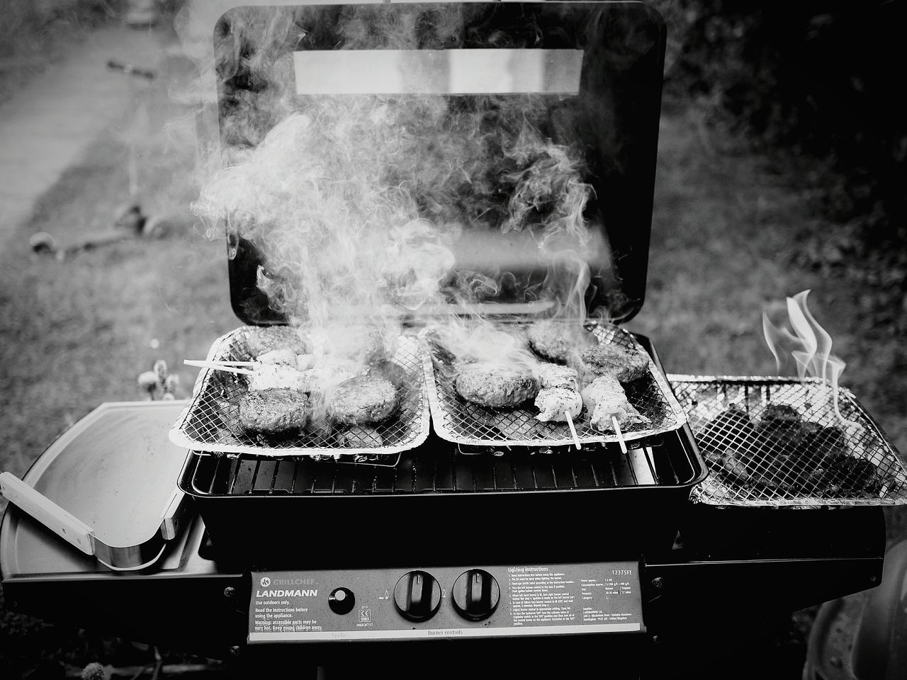 smoke - physical structure, food and drink, barbecue grill, preparation, food, heat - temperature, barbecue, burning, grilled, freshness, preparing food, indoors, meat, healthy eating, no people, sausage, close-up, flame, steam, day